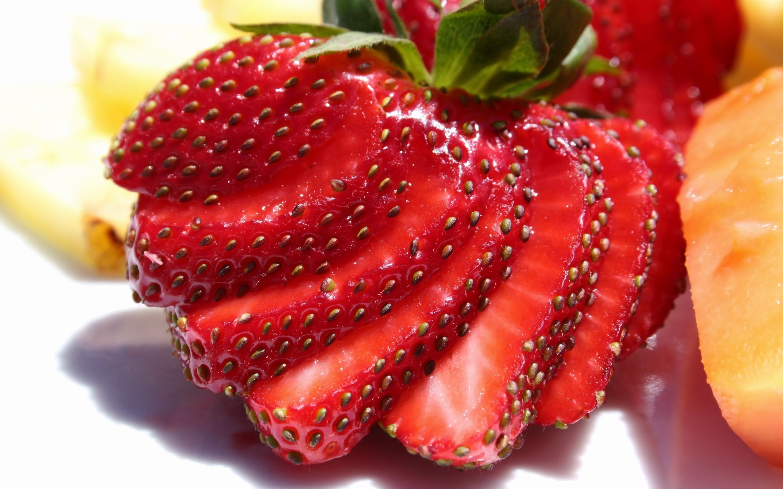 2560x1600 Sliced strawberries Wallpaper Images