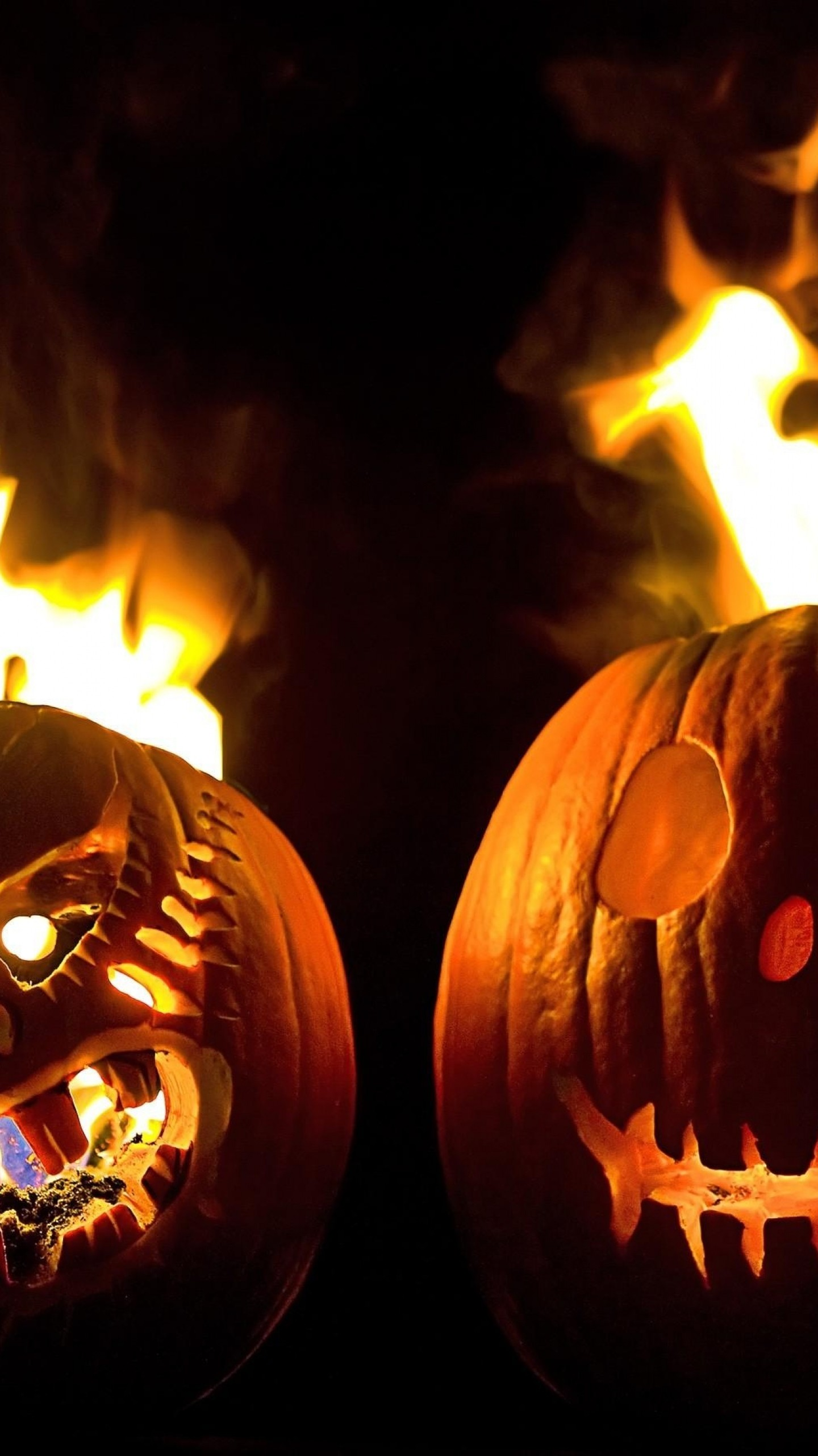 1440x2560 Preview wallpaper halloween, holiday, pumpkin, faces, steam, fire, black  background