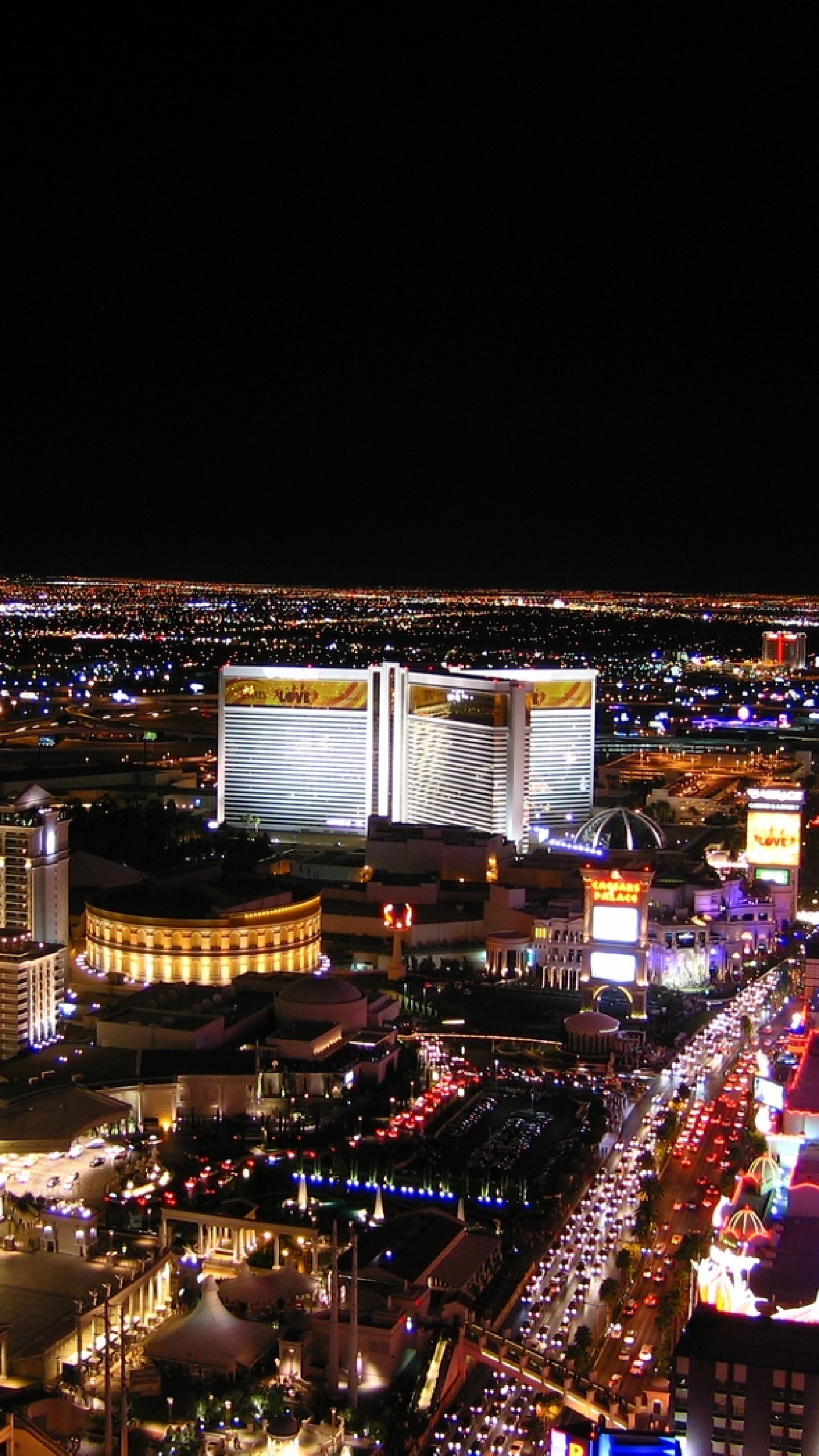1440x2560  Wallpaper las vegas, night, hotels, roads, cars