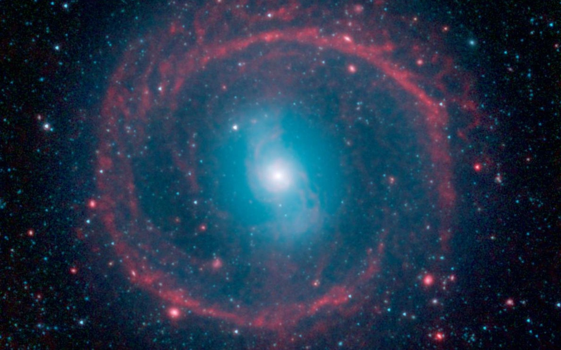 1920x1200 This image from NASA's Spitzer Space Telescope shows where the action is  taking place in galaxy