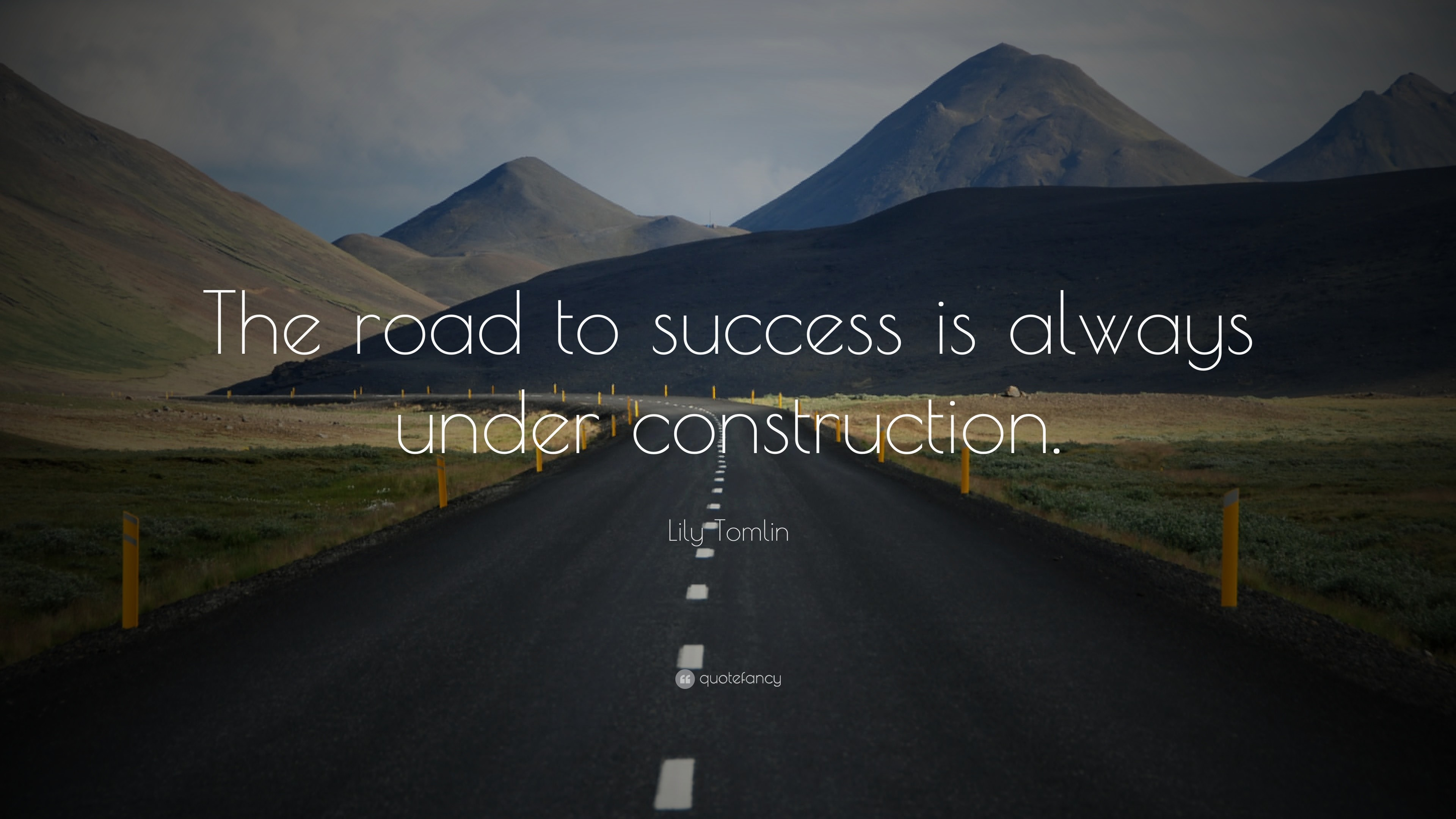 "3840x2160 Lily Tomlin Quote: ""The road to success is always under construction."""