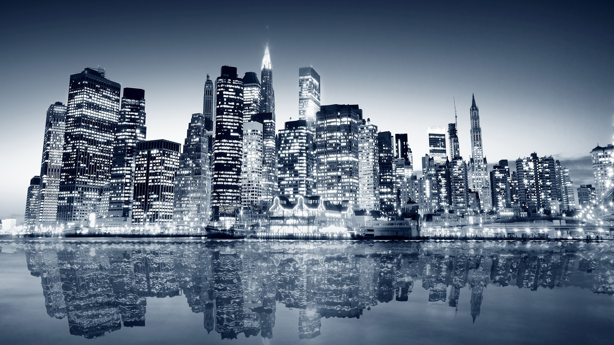 2560x1440 Preview wallpaper water, overnight, skyscrapers, new york, manhattan