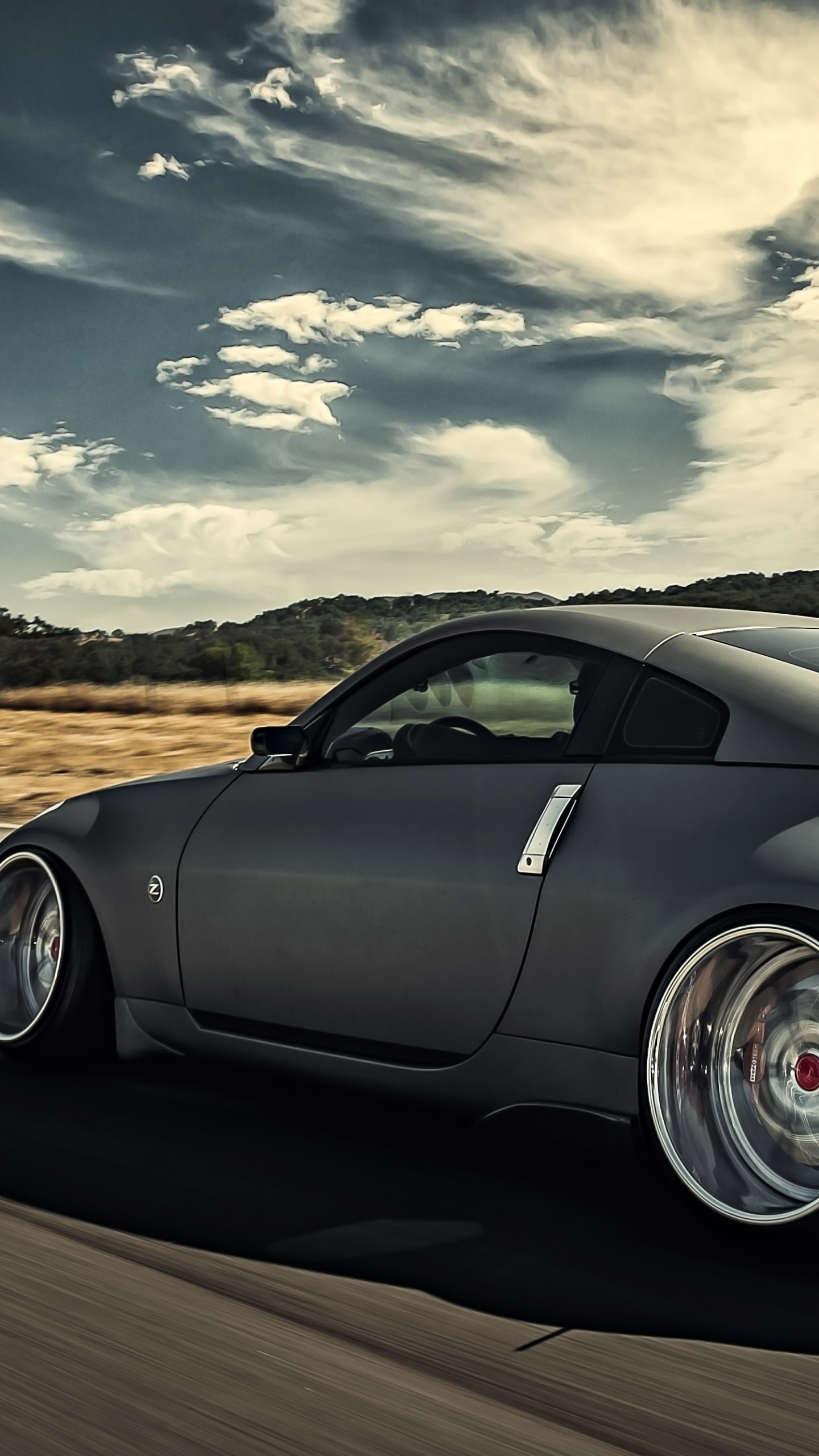 1440x2560 Preview wallpaper nissan, 350z, stance, movement, speed, side view
