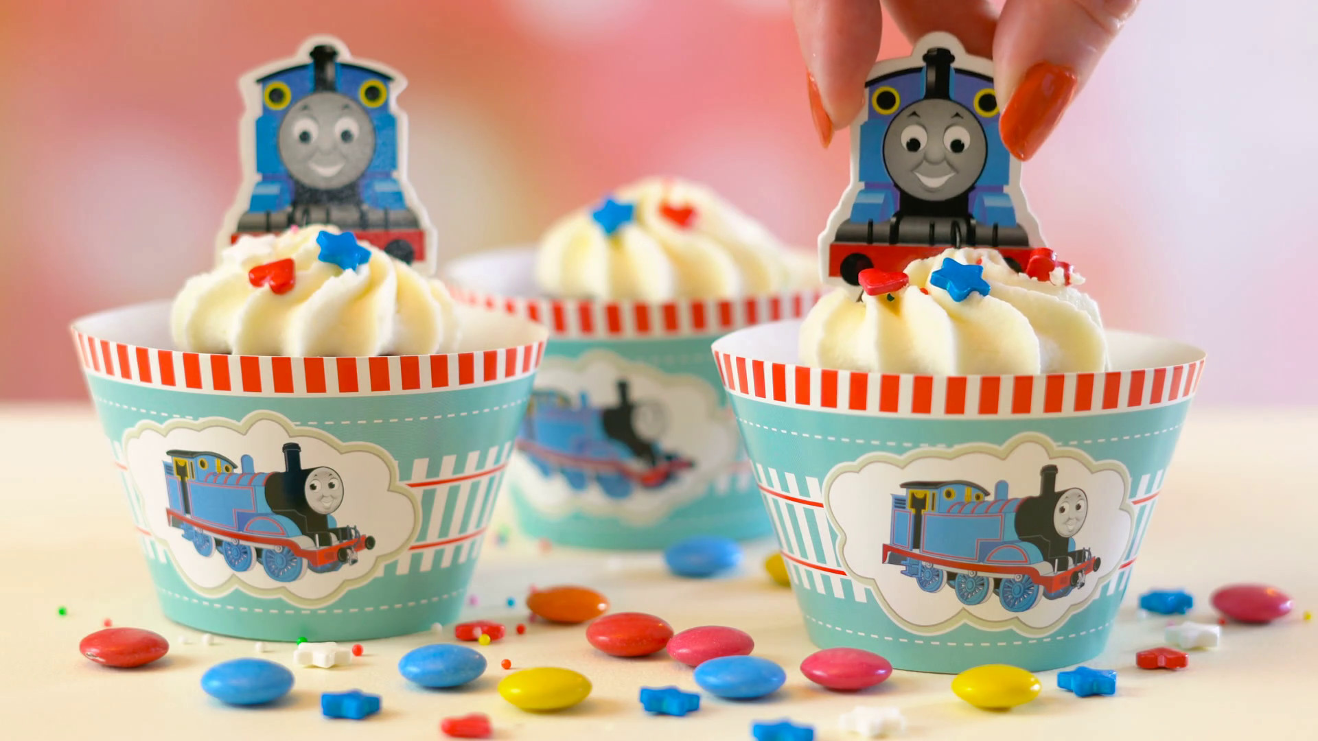 1920x1080 ... children's birthday party Thomas the Tank Engine themed cupcakes, close  up against a colorful pastel background. Stock Video Footage - Storyblocks  Video