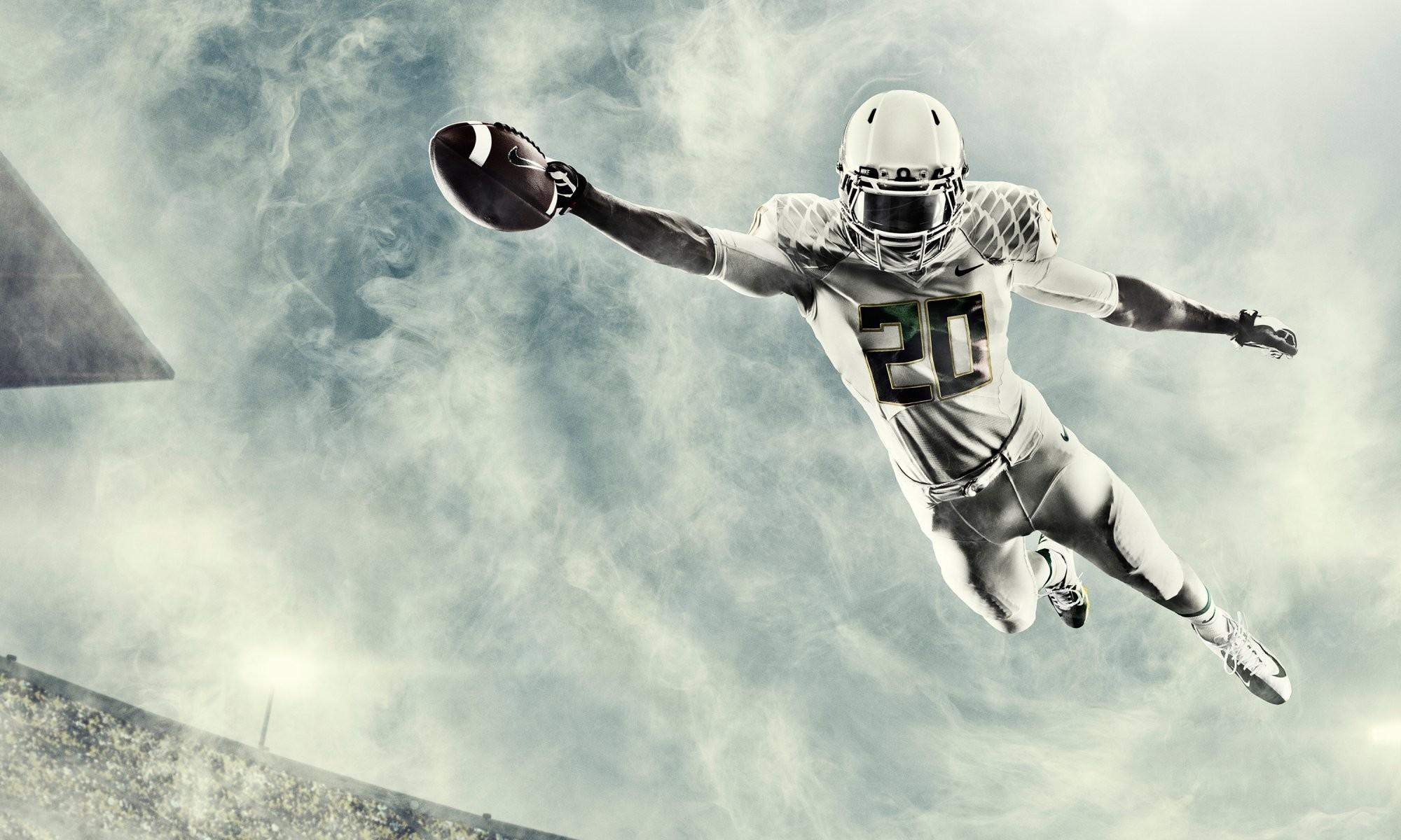 2000x1200 Football Ncaa Oregon College Athlete Helmet Jump Ball