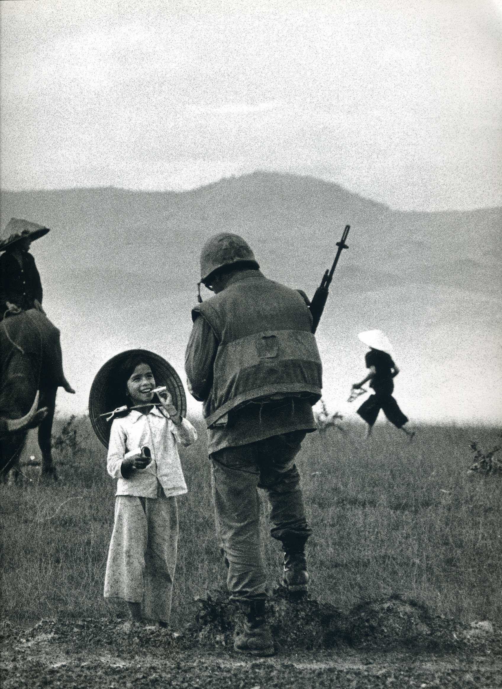 1697x2331 A solider chats with a young country girl. Vietnam, c.1967 by Philip Jones  Griffith [1697 x 2331] ...