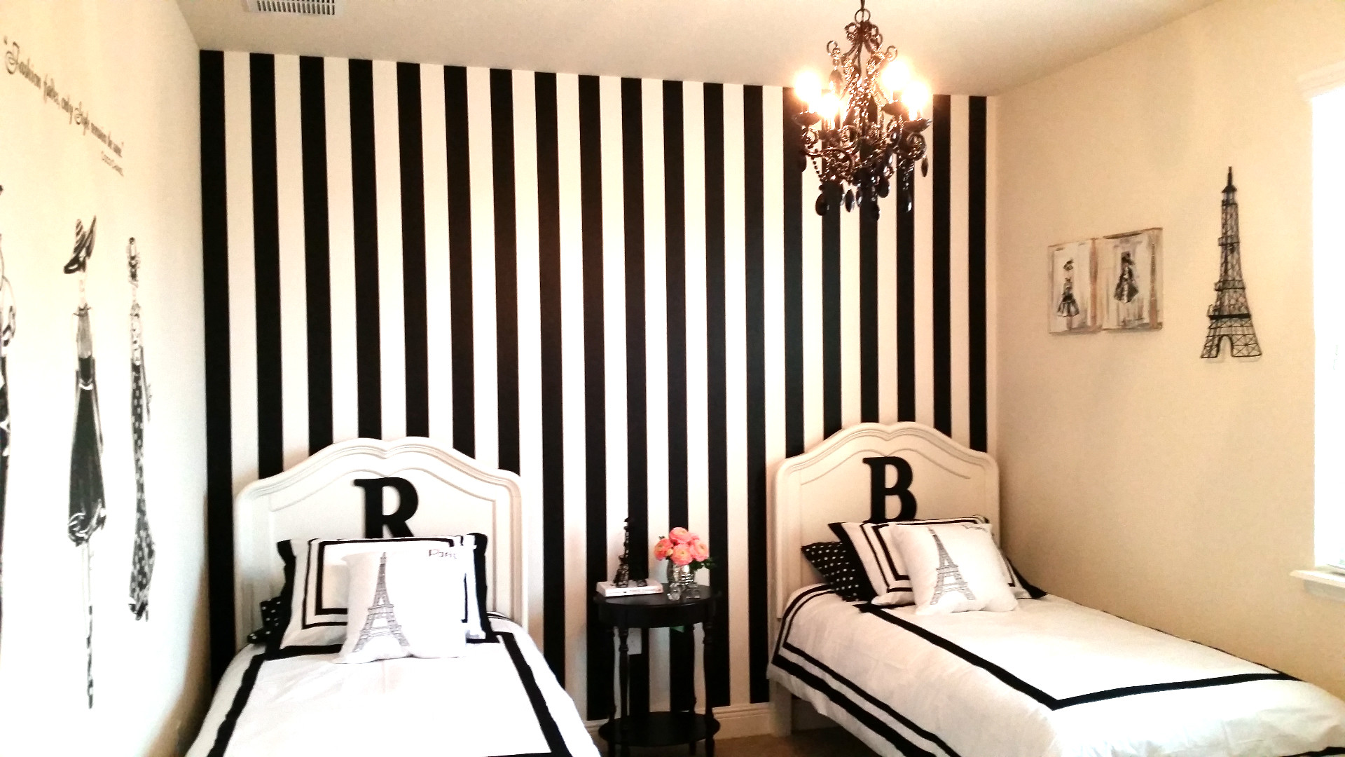 1920x1080 double beds with Paris Themed Bedding before the white and black stripped  wall plus black chandelier