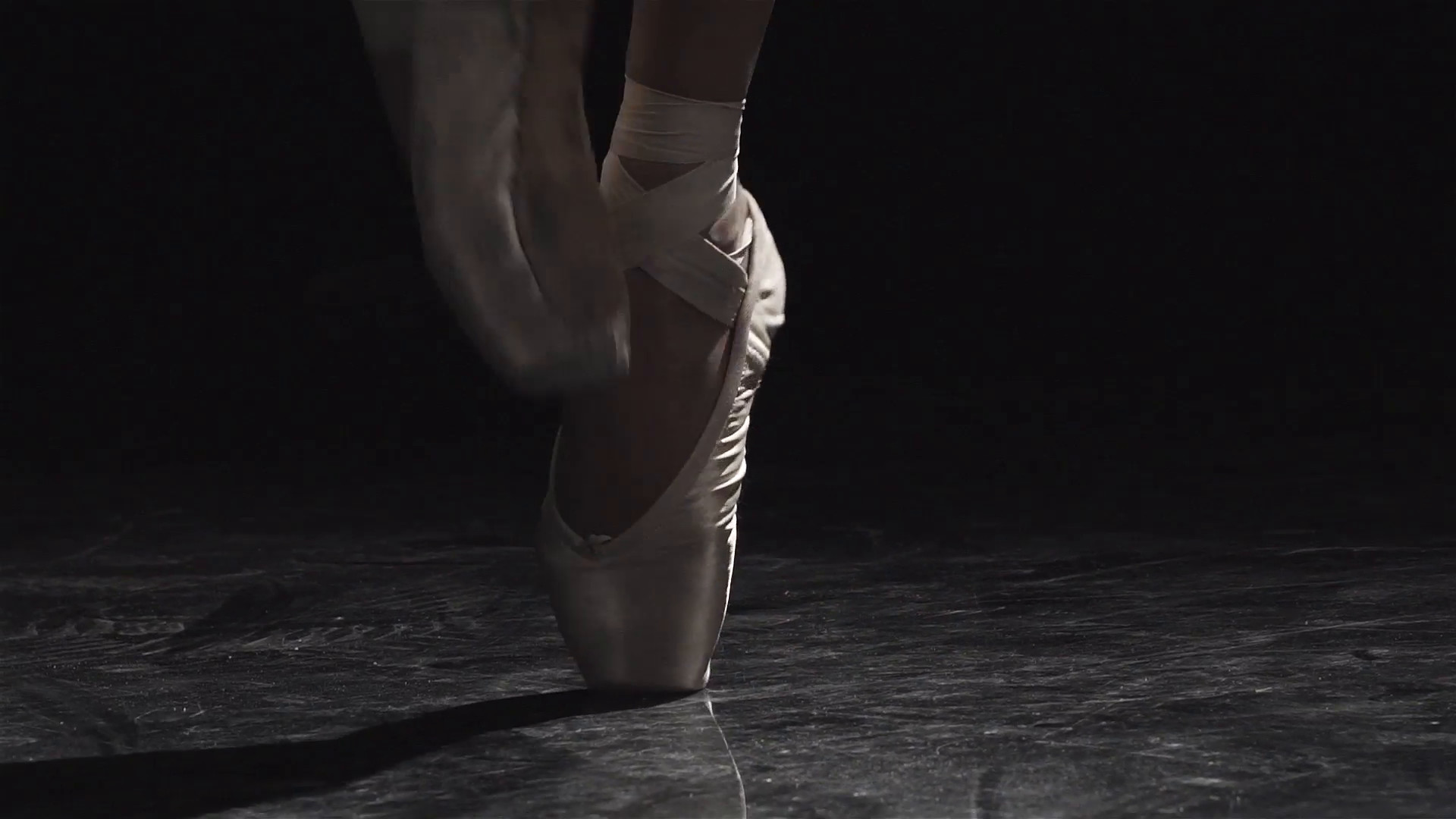 1920x1080 Slow motion close up shot of a ballet dancers feet as she practices in the  dark studio Stock Video Footage - Storyblocks Video