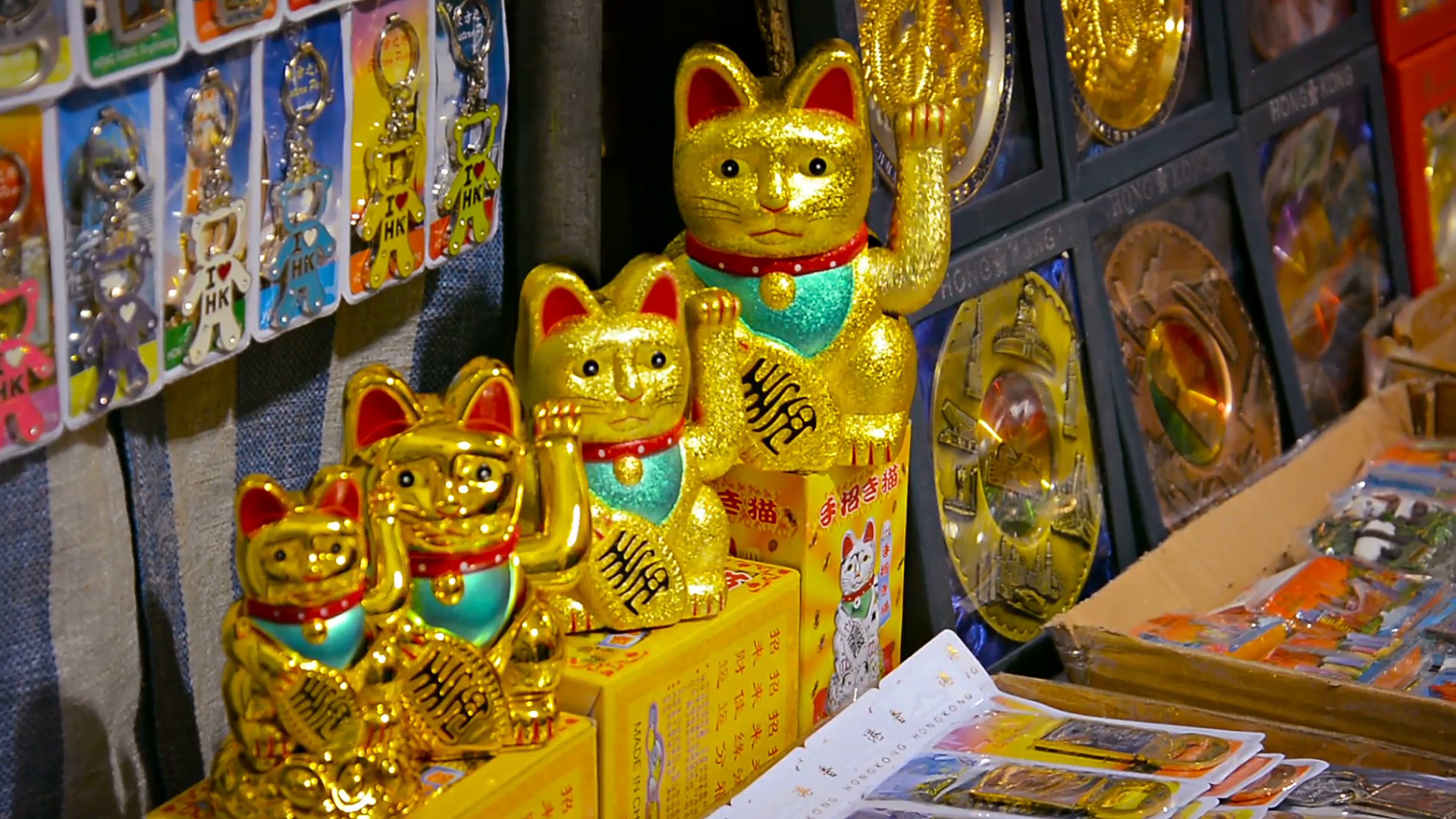 1920x1080 Japanese lucky cat statues. with their perpetual waving arms. for sale at a  souvenir shop. amongst other collectibles. Stock Video Footage -  Storyblocks ...