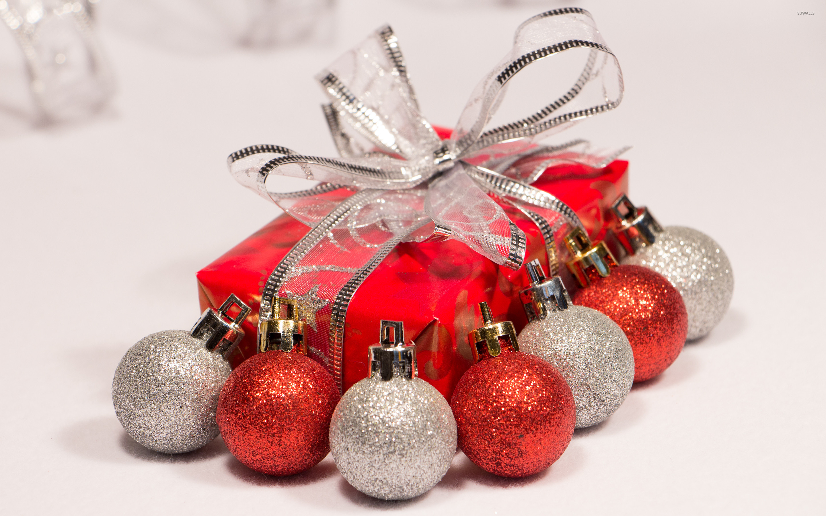 2880x1800 Red and silver baubles by the Christmas present wallpaper