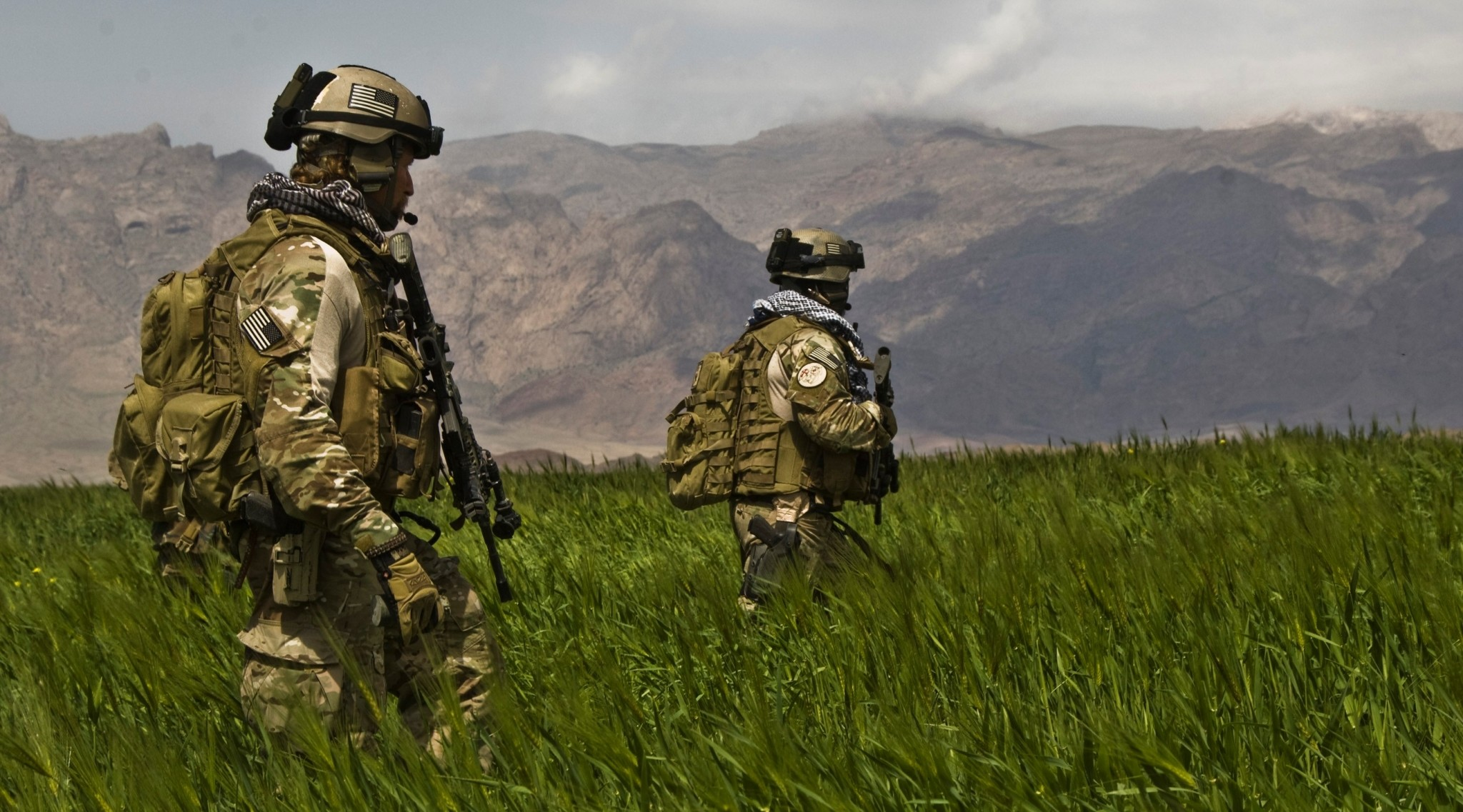 2048x1137 Army Special Forces (Green Berets) members from the Special Forces Group  (Airborne) on foot patrol in Afghanistan.