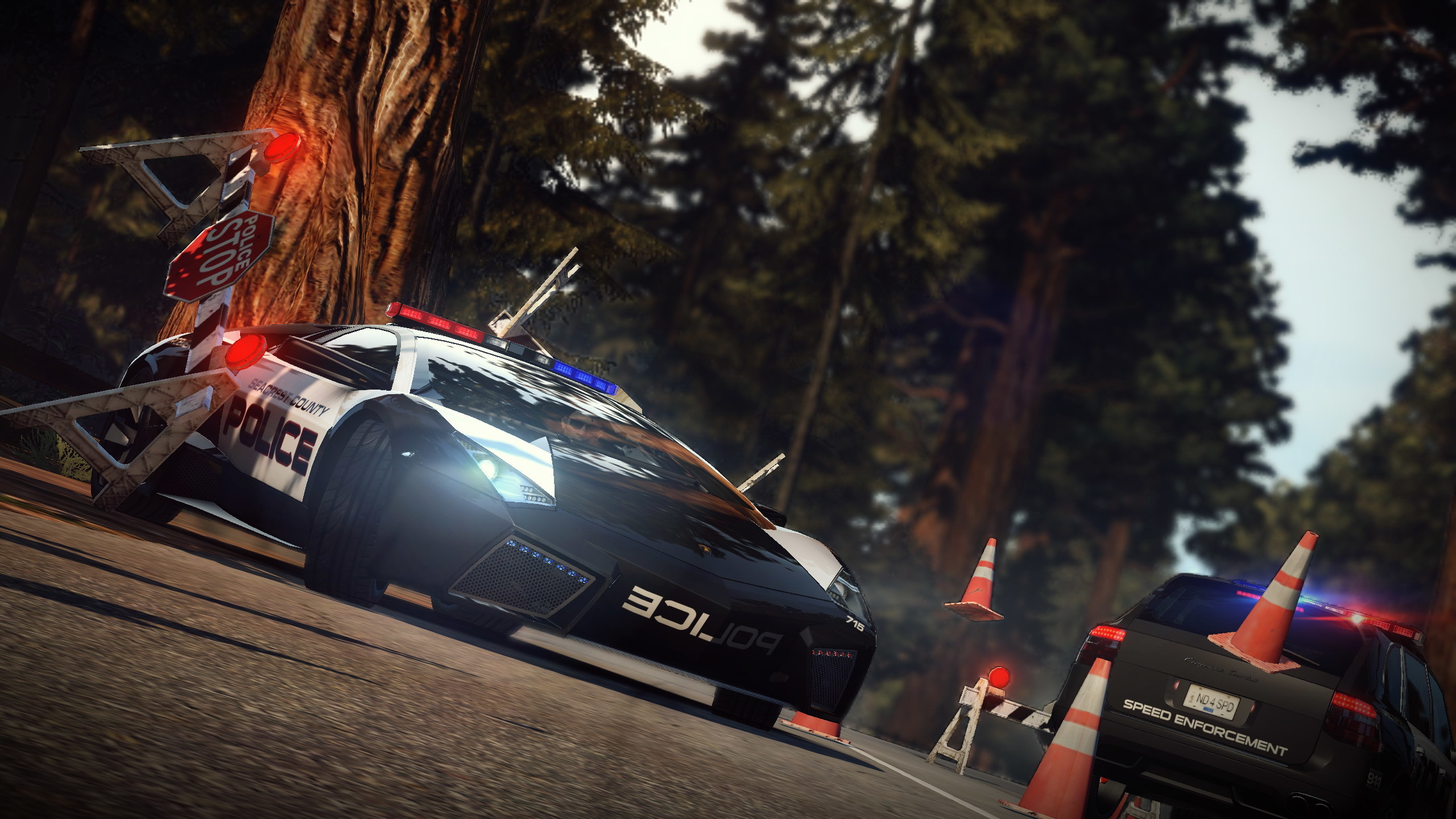 2560x1440 Need For Speed Hot Pursuit Police Car Break The Obstacles   Resolution