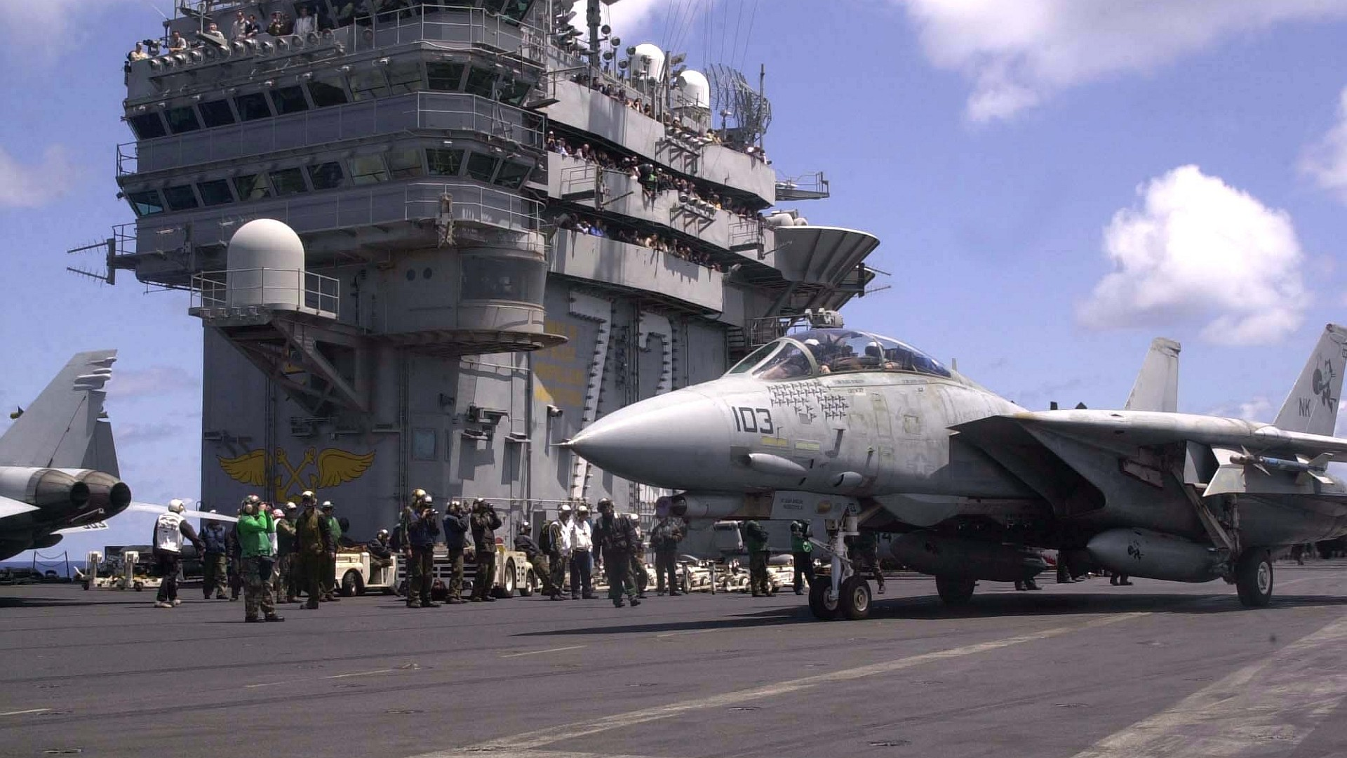 1920x1080  HD wallpaper of a F-14 Tomcat preparing for carrier take-off. The  widescreen version (1920x1200) of this #wallpaper can be found at ...