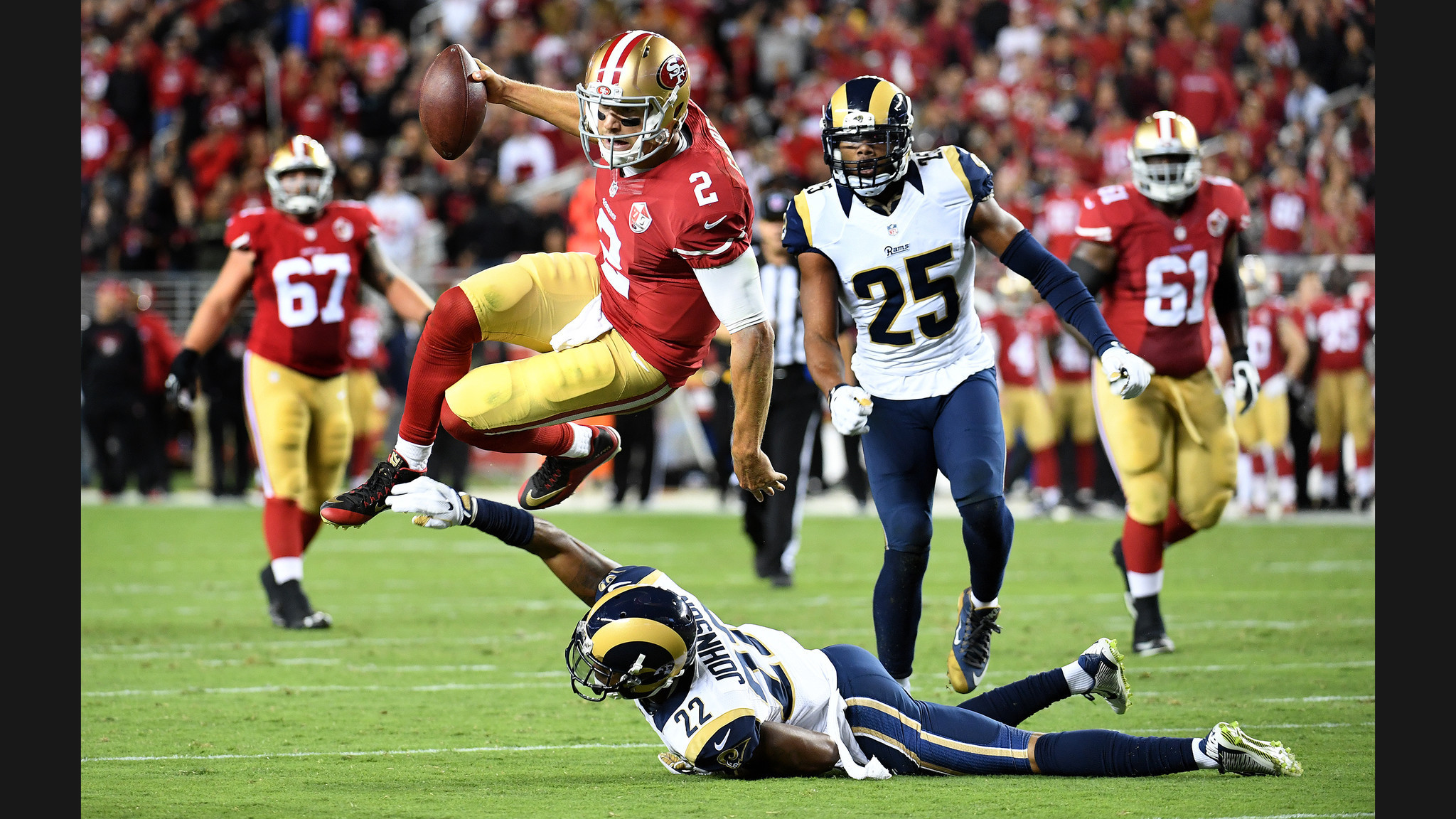 2048x1152 49ers quarterback Blaine Gabbert leaps for a 1st down over Rams cornerback  Trumaine Johnson in the