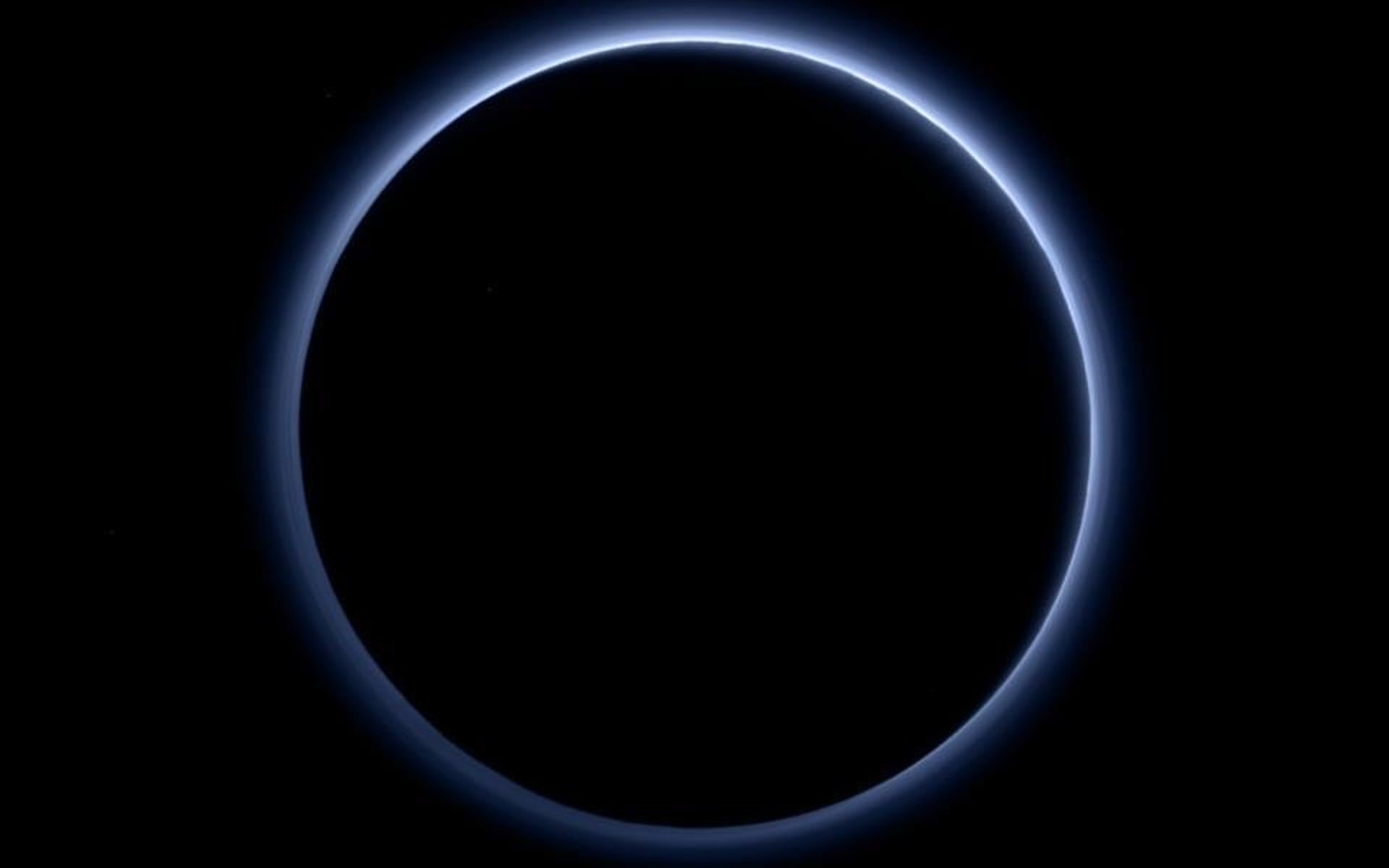 1920x1200 Pluto's haze layer shows its blue color in this picture taken by NASA's New  Horizons.