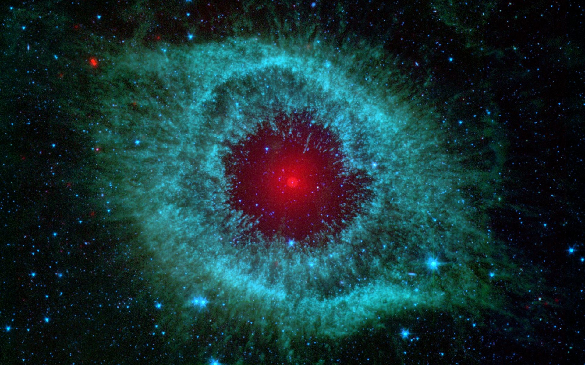 1920x1200 This infrared image from NASA's Spitzer Space Telescope shows the Helix  nebula, a cosmic starlet