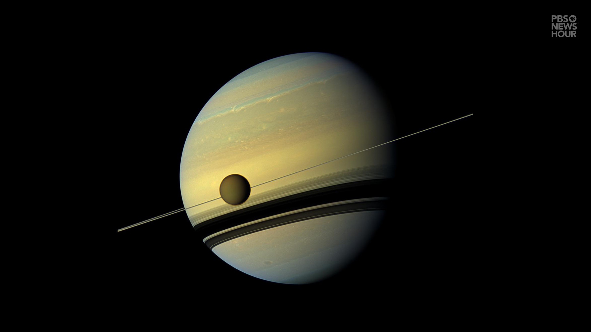 1920x1080 Titan, Saturn's largest moon, appears in front of the planet and its icy  rings