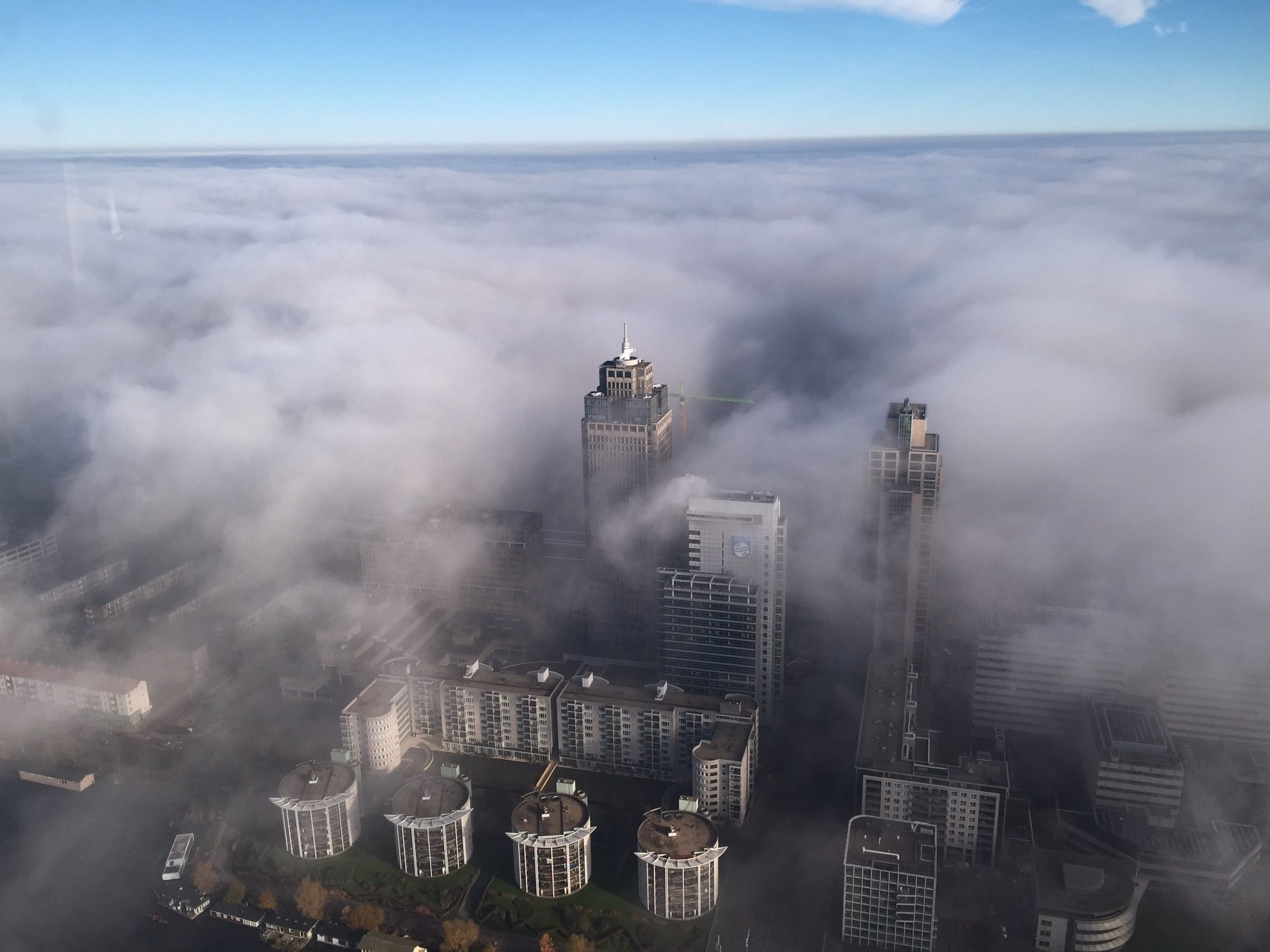 2048x1536 Mist around the Rembrandt tower today - picture by a police helicopter  wallpaper/ background for iPad mini/ air/ 2 / pro/ laptop