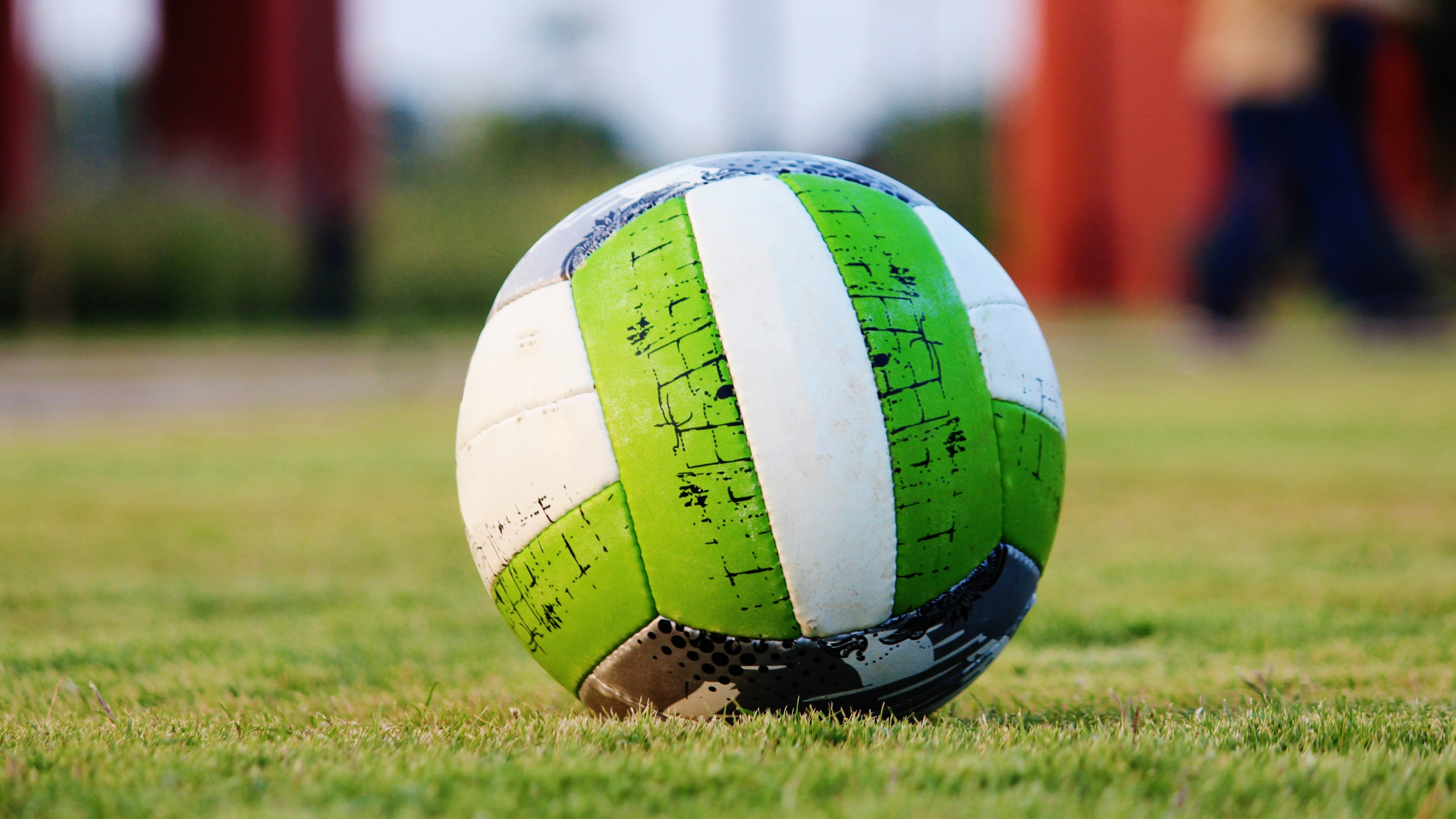 3840x2160  Wallpaper soccer ball, grass, green