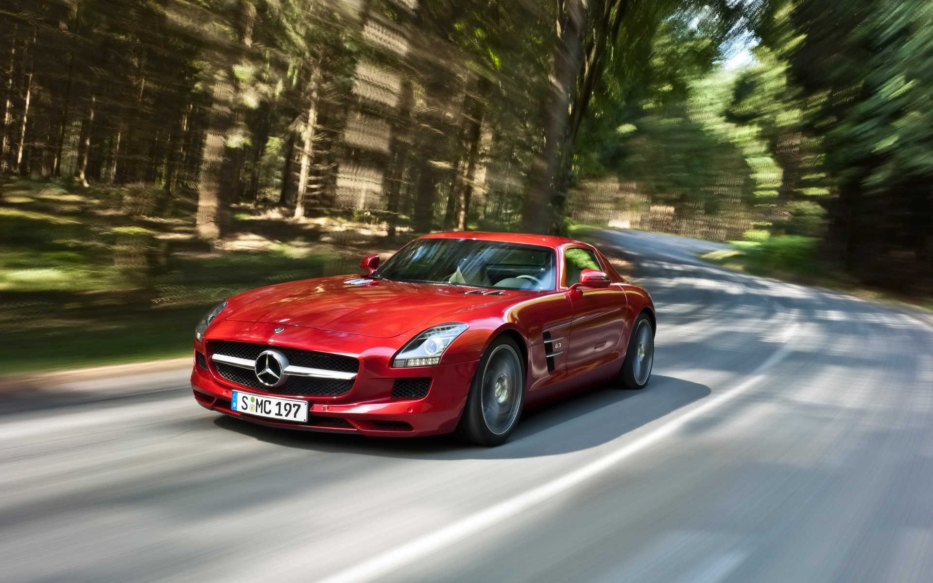 1920x1200 Red Mercedes-Benz SLS AMG on a forest road