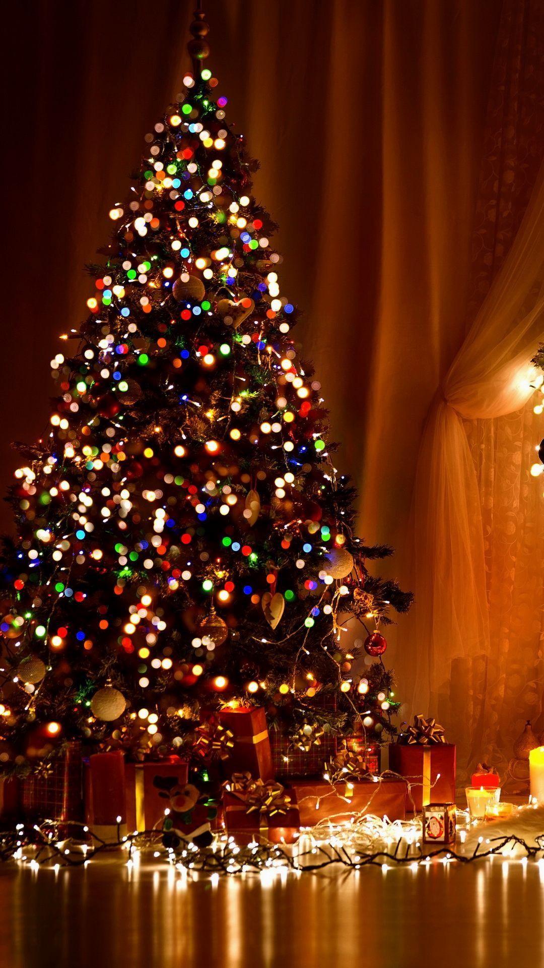 1492281 vertical christmas lights iphone wallpaper