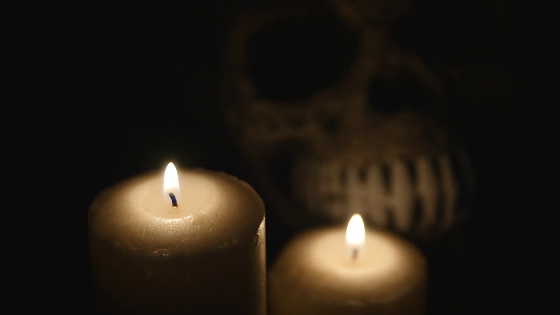 1920x1080 four lighted candles and a skull on a black background. close up Stock  Video Footage - Storyblocks Video