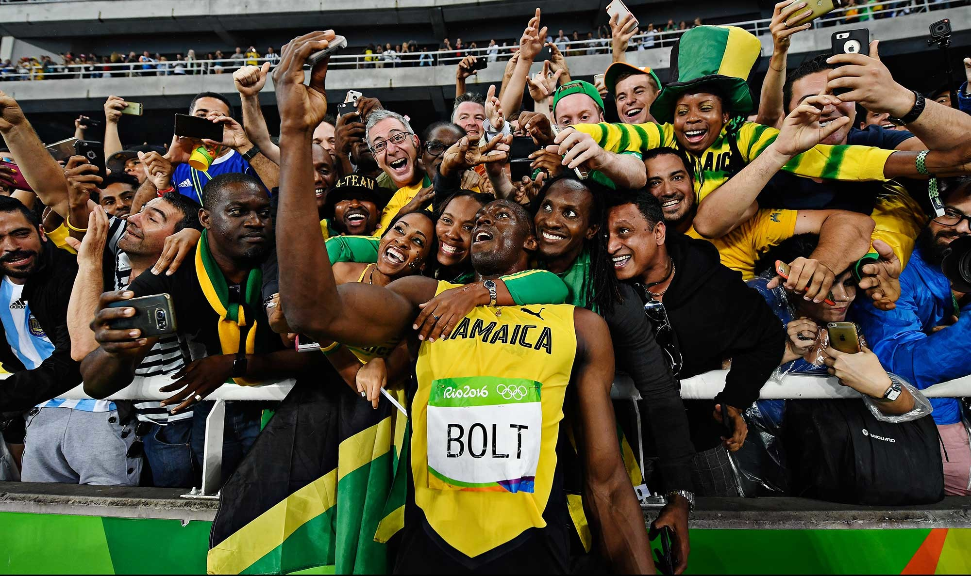 2000x1188 Usain Bolt takes photos with fans after winning perhaps his last individual  Olympic race.