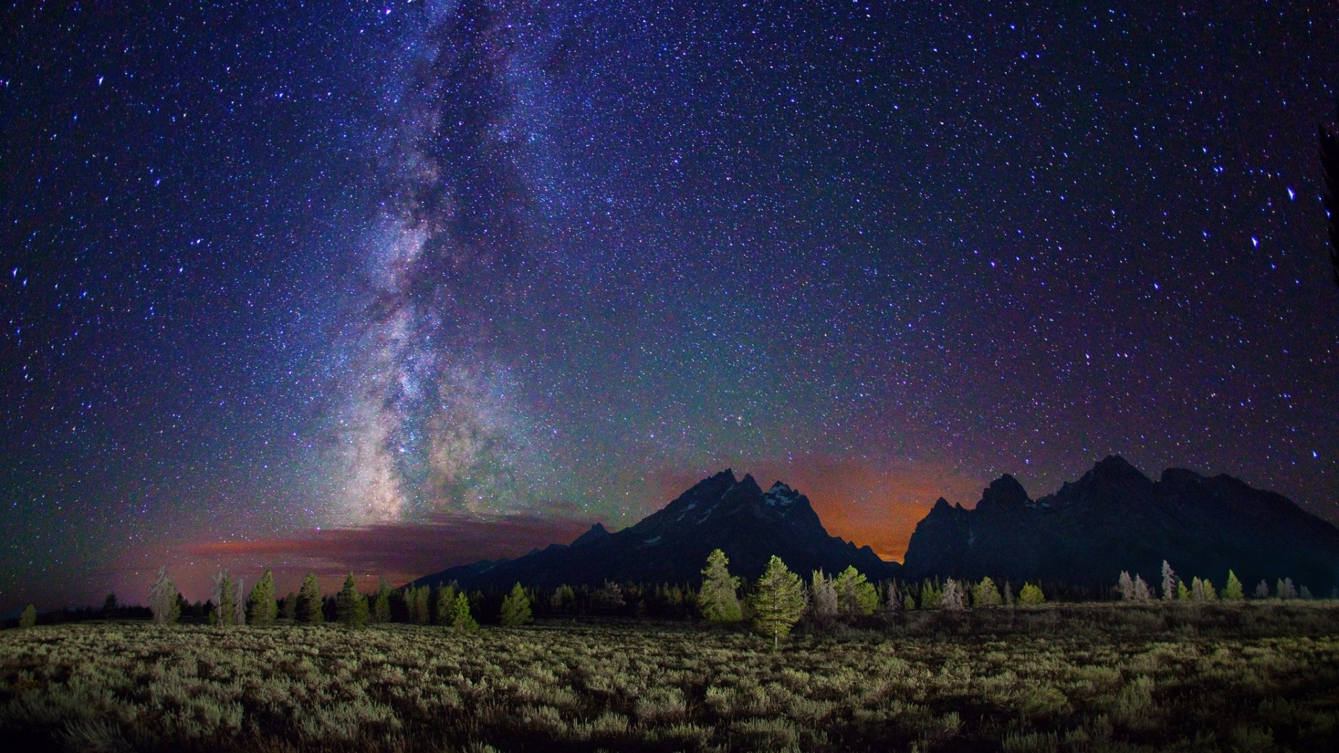 1920x1080 Preview wallpaper milky way, stars, mountains, field, night