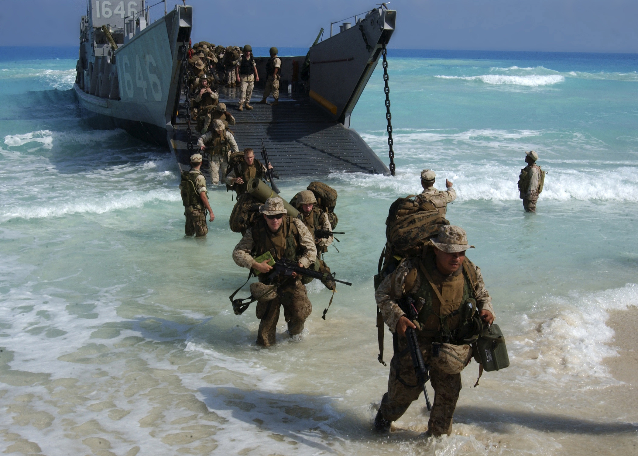 2100x1500 U.S. Marines from Expeditionary Strike Group One, 13th Marine Expeditionary  Unit wade ashore from a