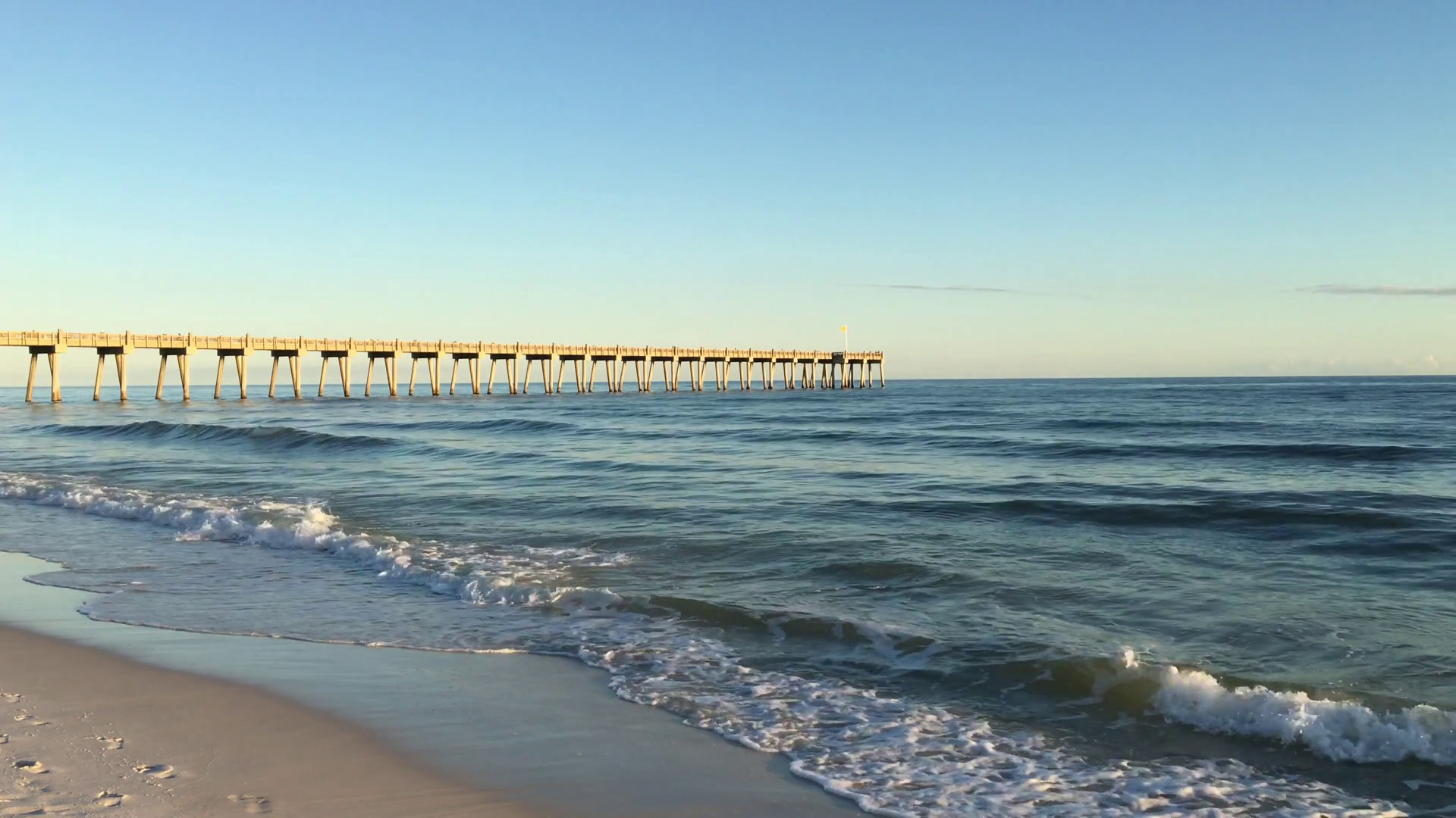 1920x1080 Gulf of Mexico waves roll into the shore with the Pensacola Beach Pier in  the background. Stock Video Footage - Storyblocks Video