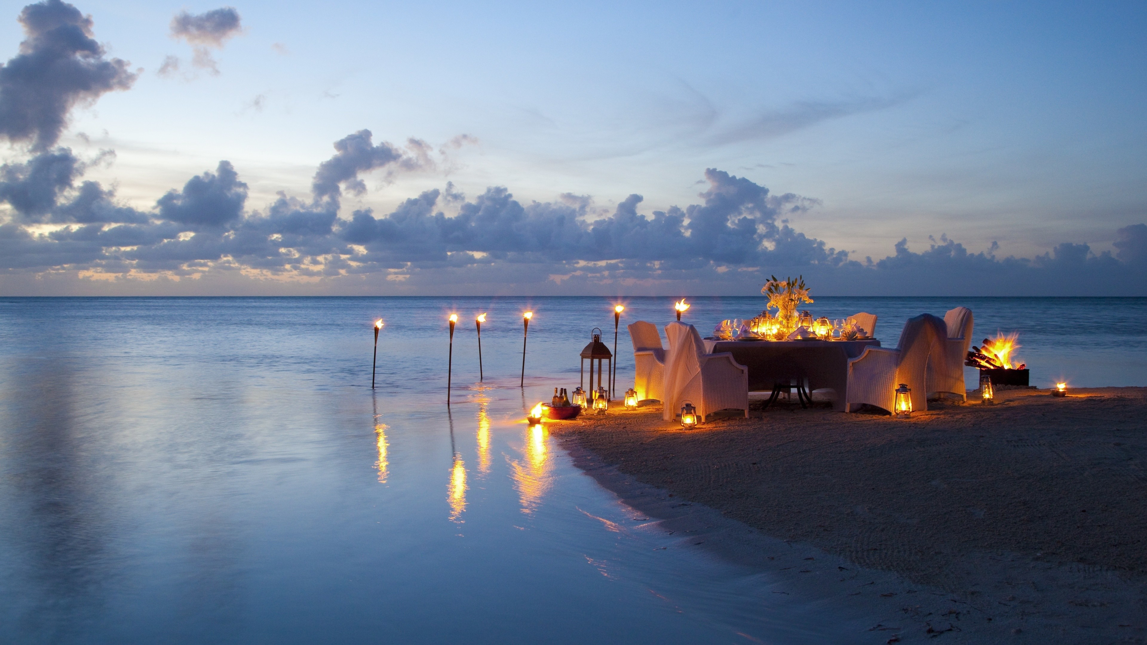 3840x2160 Romantic Candle Light Dinner At Beach