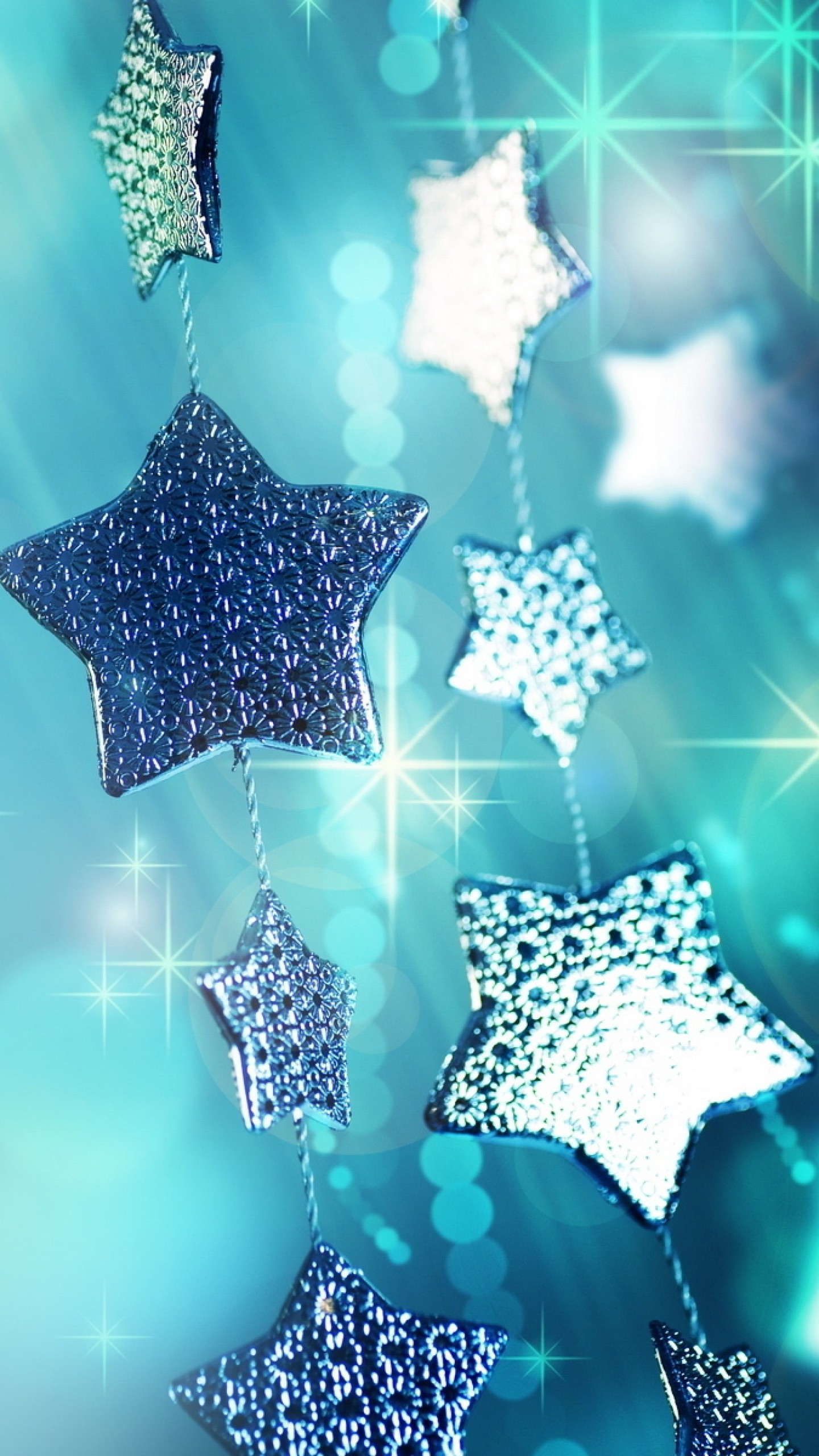 1440x2560 Preview wallpaper glitter, garland, blue, christmas ornaments, stars,  sparks, macro