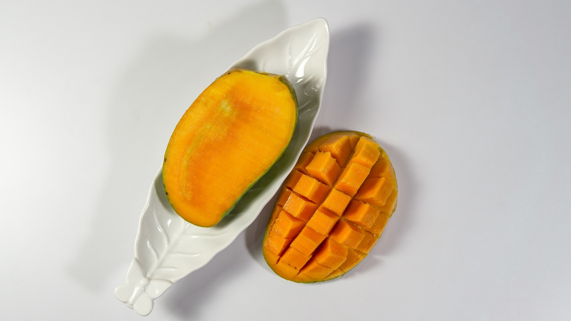 1920x1080 Ripe Mango Chopped with White Background