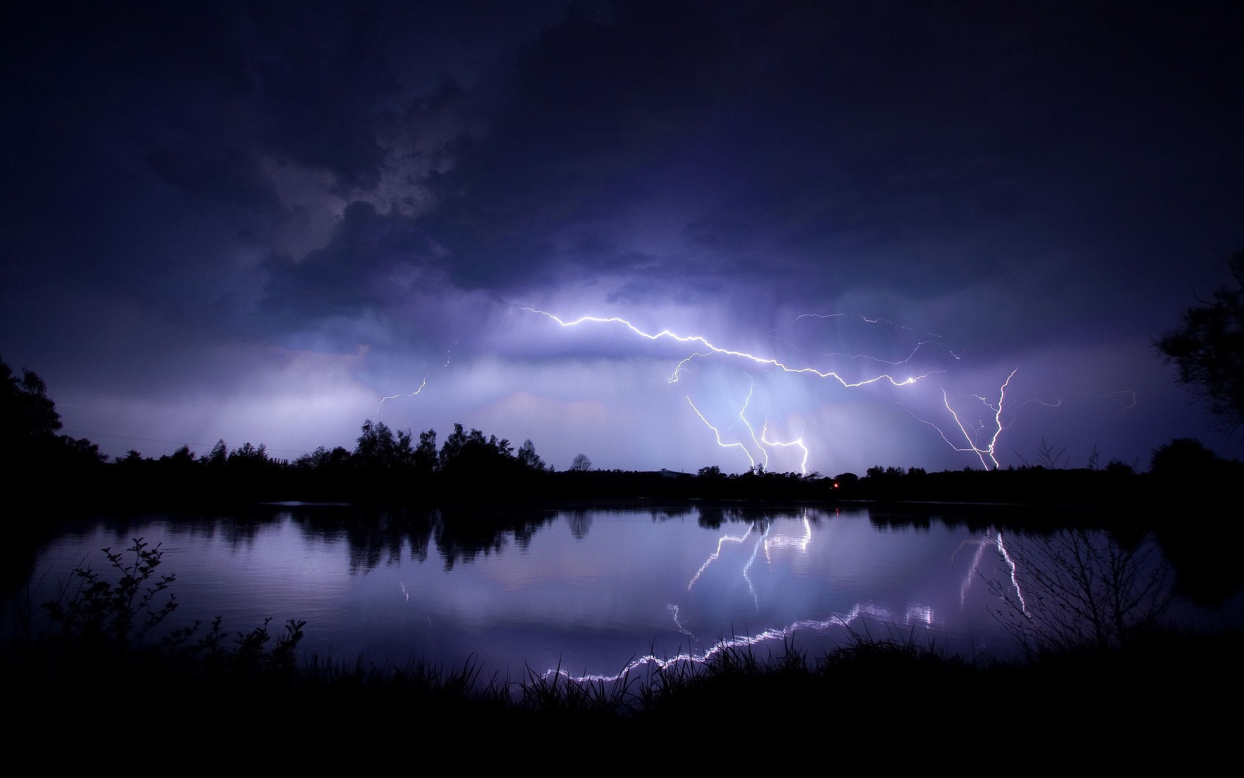 2560x1600 Lightning-striking-the-lakeside-night-storm-nature-hd-