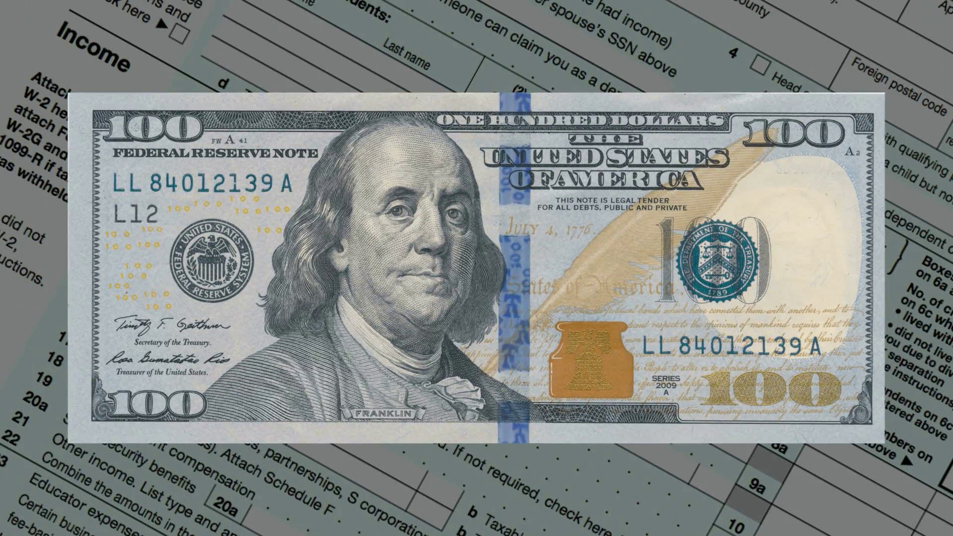 1920x1080 Income tax form with expanding one hundred dollar bill Motion Background -  VideoBlocks