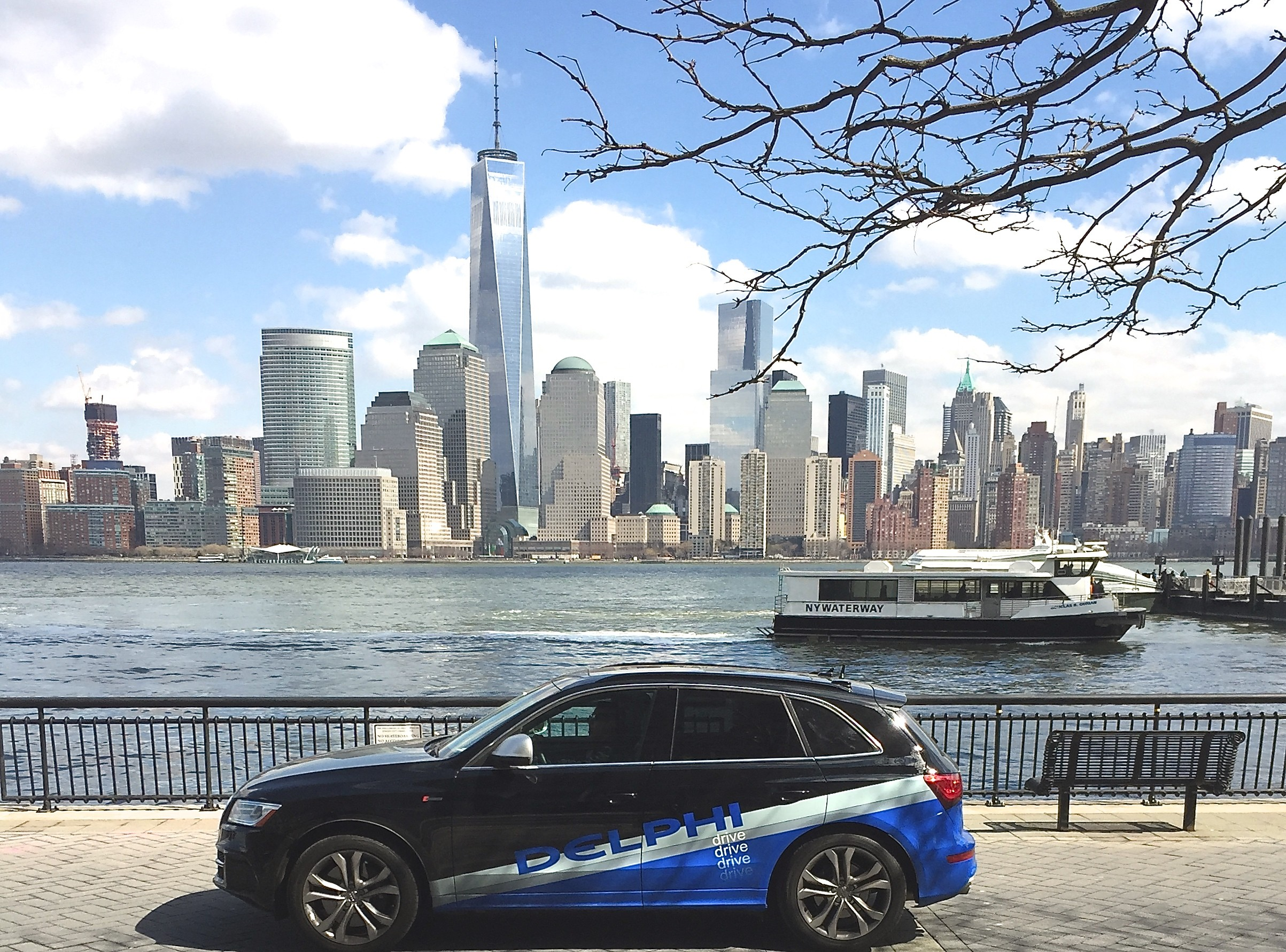 2406x1782 autonomous-driving-car-in-front-of-nyc-skyline-