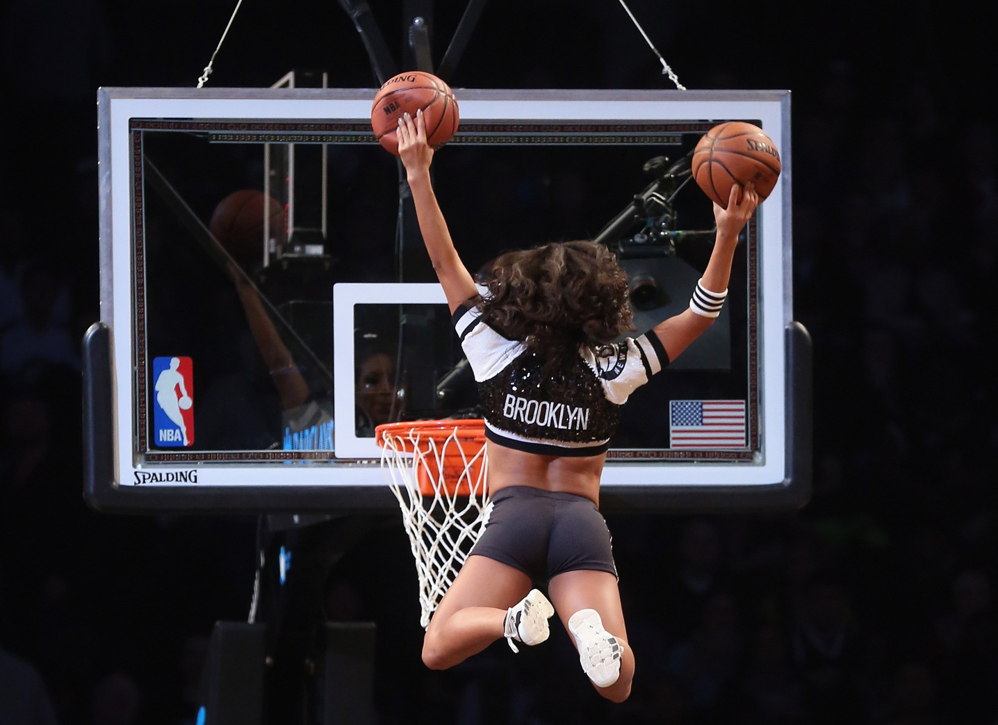 2000x1452 A Brooklynette cheerleader flies in to score two during a break in the game  between the Brooklyn Nets and the Los Angeles Clippers at the Barclays  Center on ...