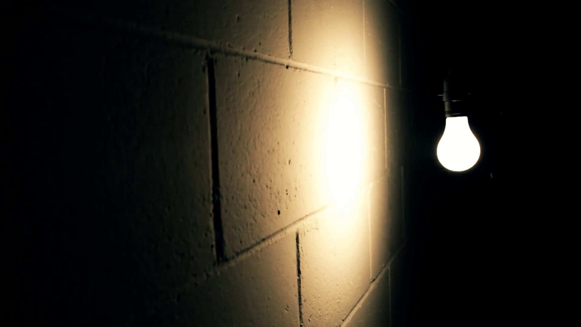 1920x1080 Light Bulb Swaying Against Wall in Dark Room Stock Video Footage -  VideoBlocks
