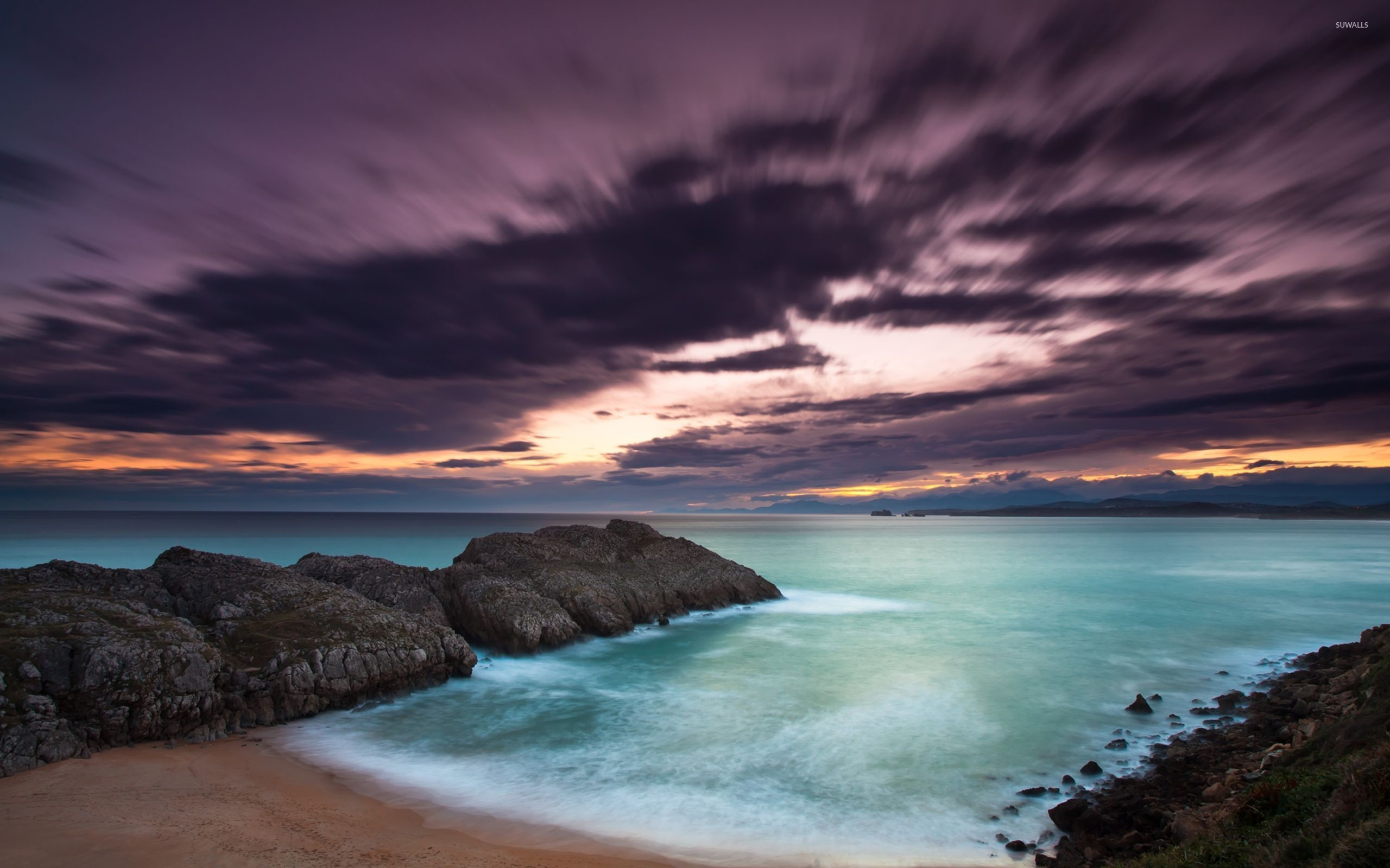 2560x1600 Purple clouds above the rocky ocean shore wallpaper