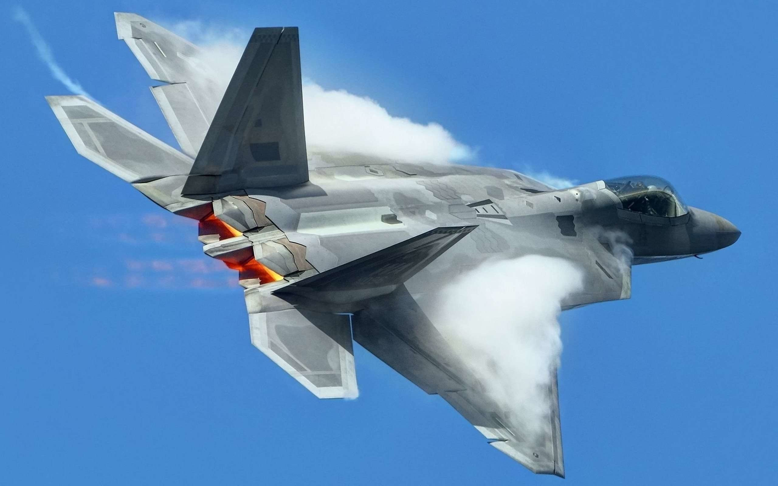 2560x1600 smoke from the back of a flying high Lockheed Martin F-22 Raptor