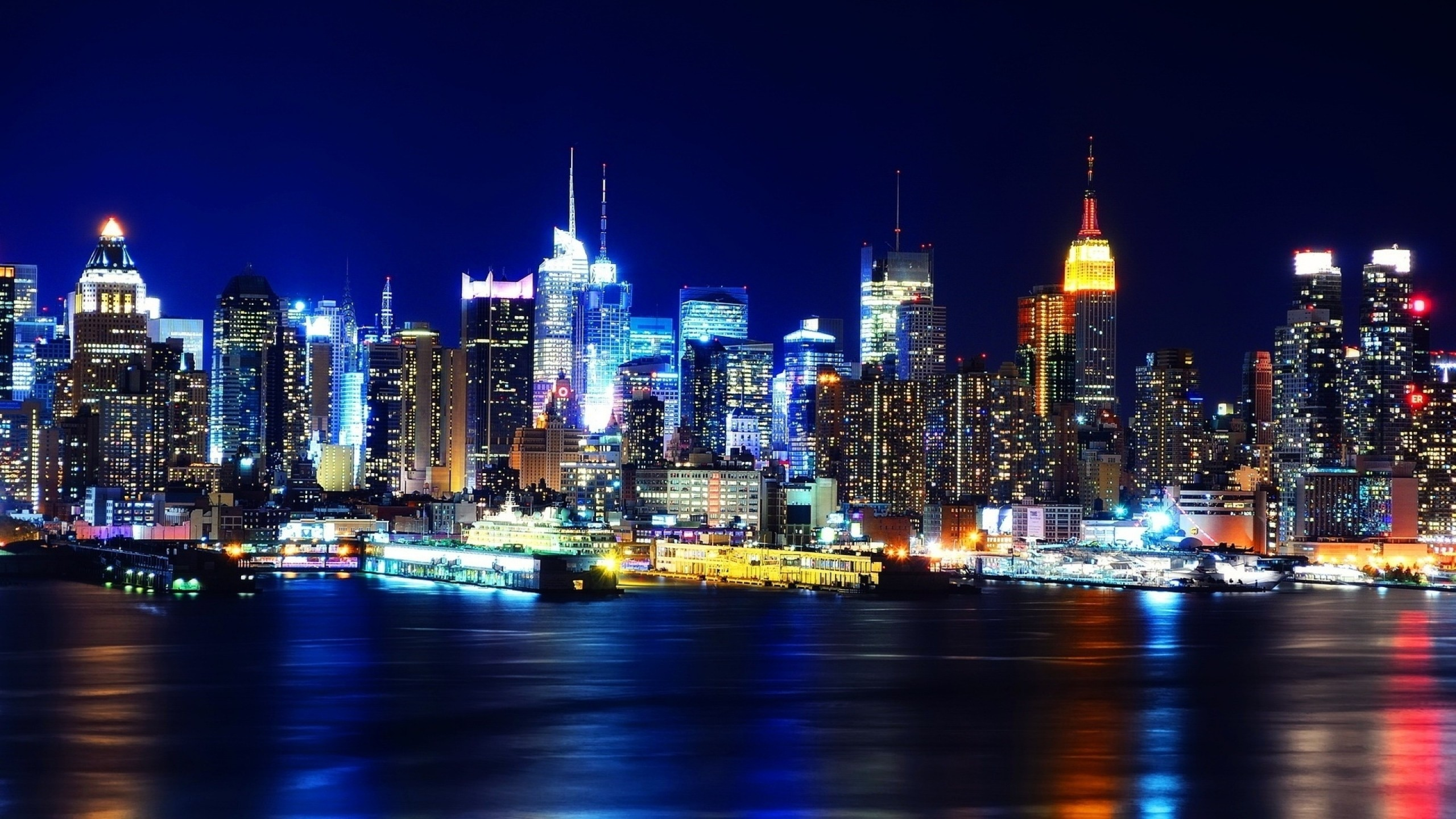 2560x1440 Preview wallpaper new york, night, lights, river, reflection
