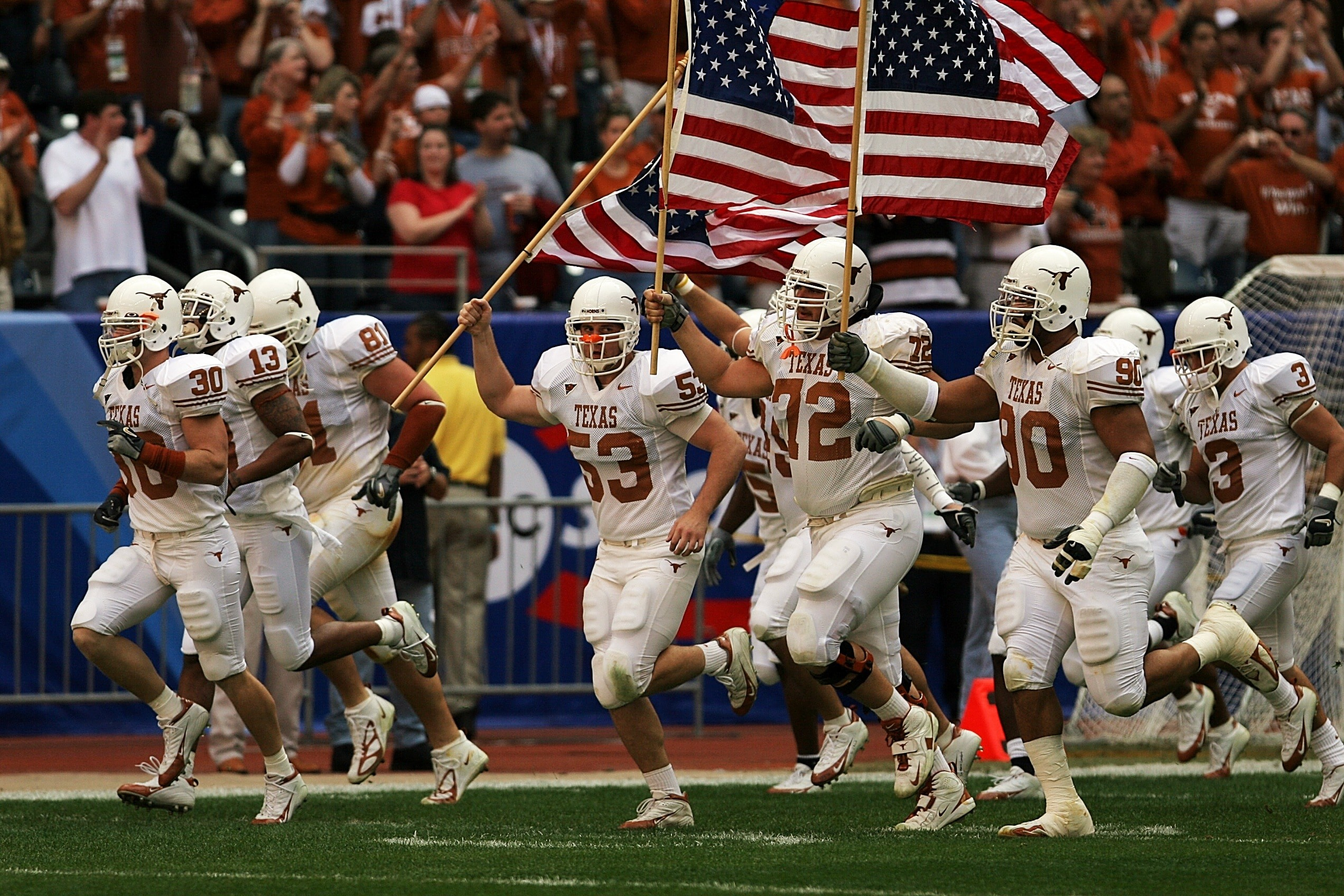 2544x1696 football in white jersey team running with american flag preview