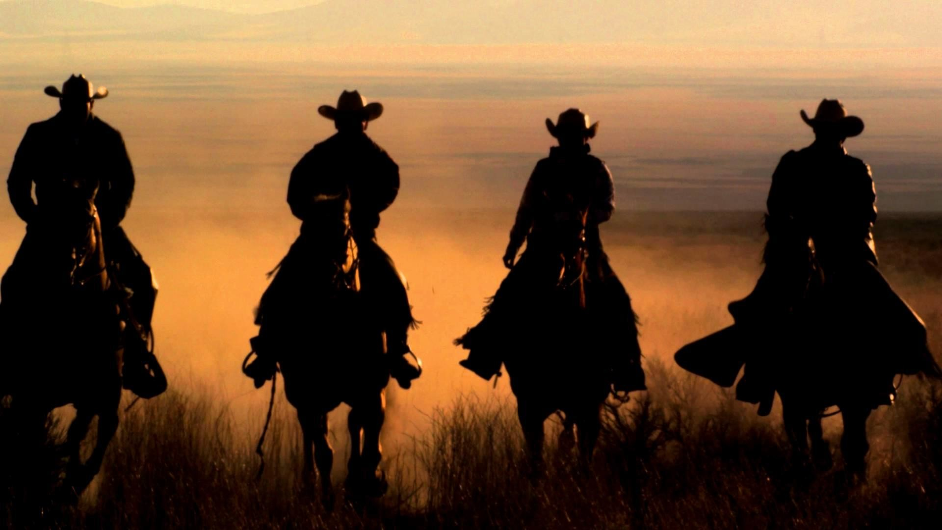 1920x1080 Slow-Motion-Panning-Shot-Of-Four-Cowboys-Riding-