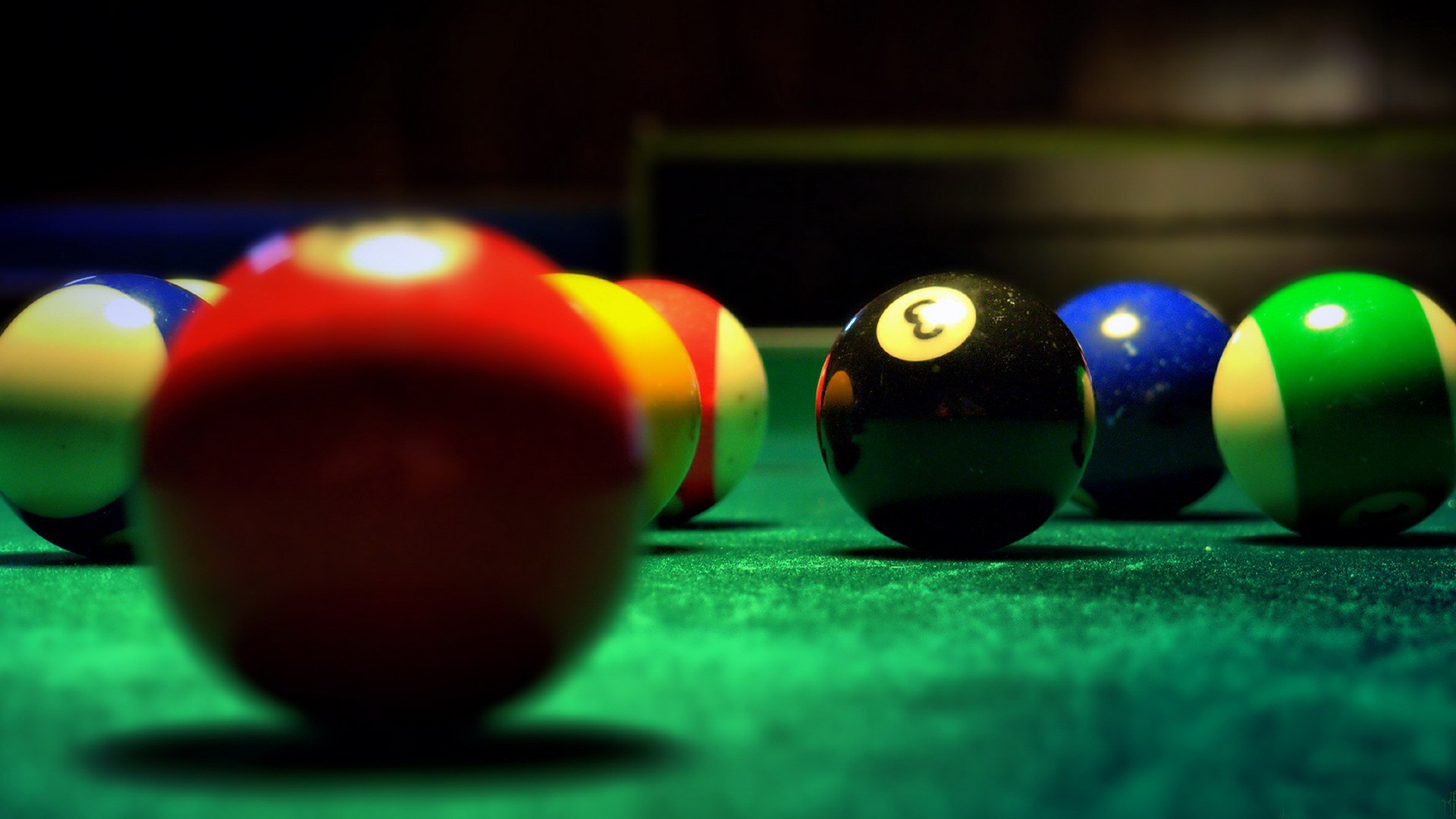 1920x1080 Picture of pool balls. The picture focuses on the black 8 ball.
