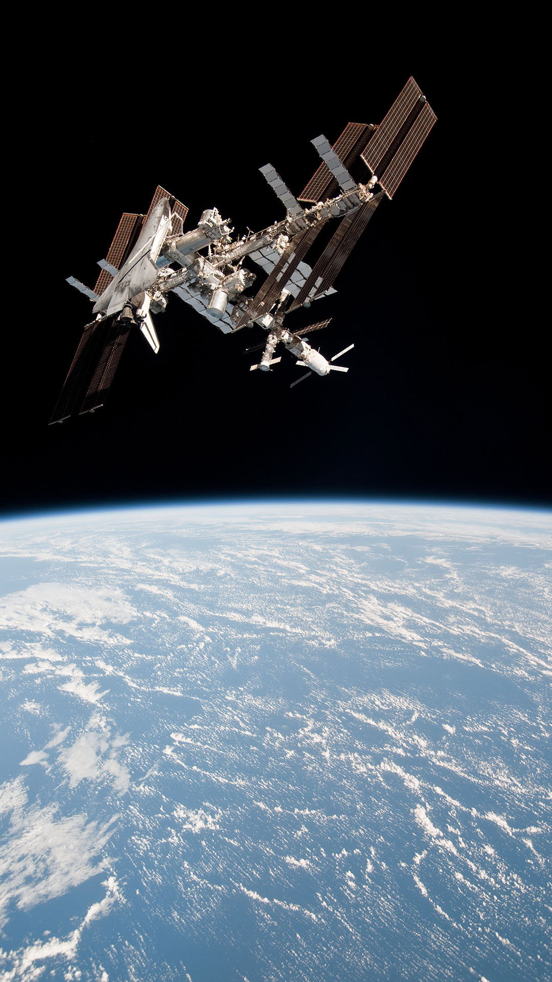 1080x1920 International Space Station orbiting Earth Wallpaper