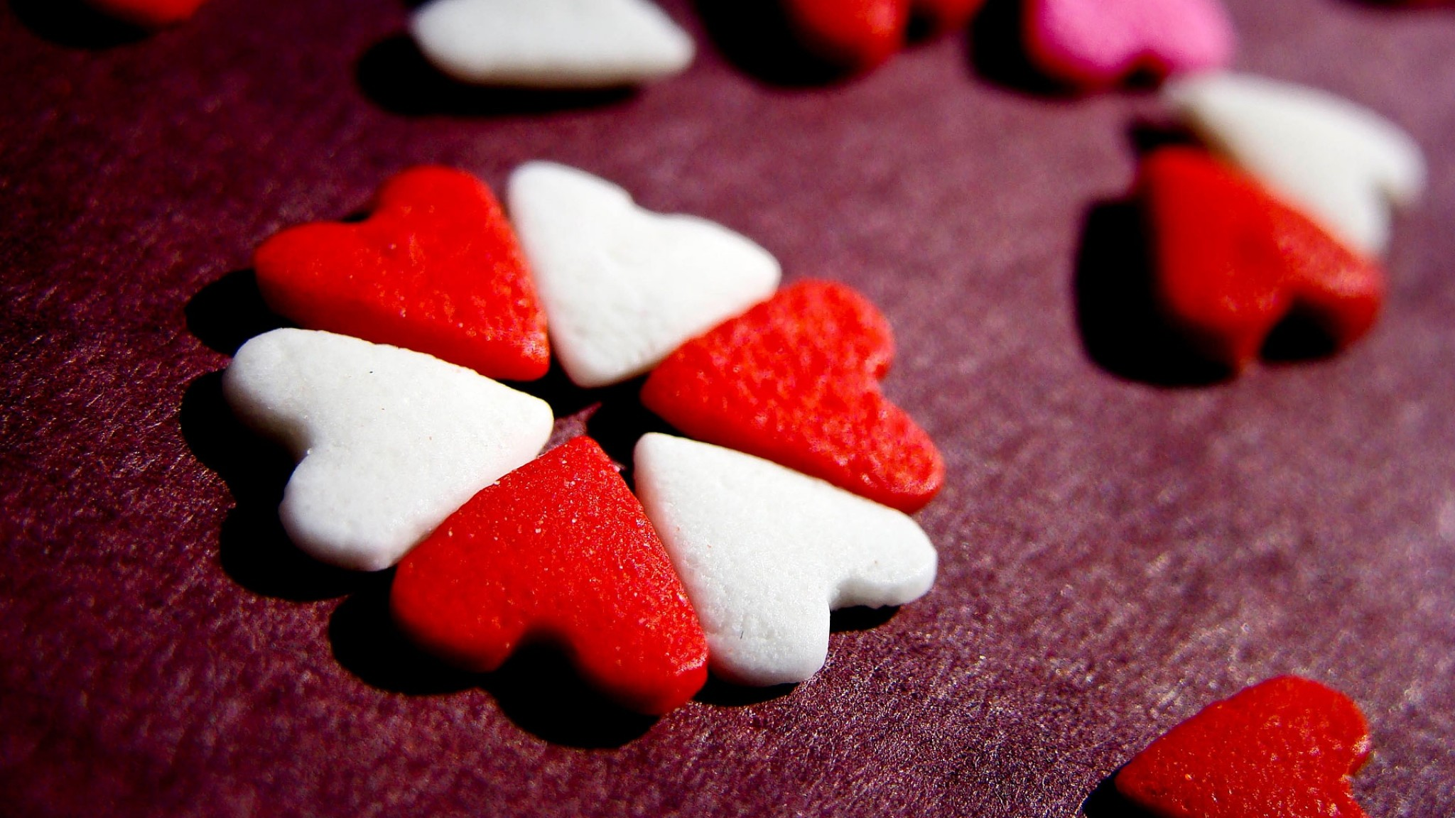 2048x1152  Wallpaper heart, candy, table, surface, shape