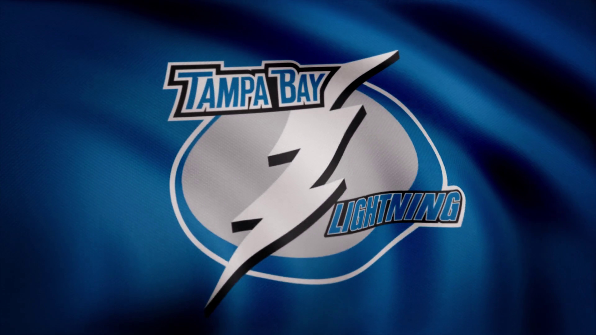 1920x1080 USA - NEW YORK, 12 August 2018: Waving flag with Tampa Bay Lightning NHL  hockey team logo. Close-up of waving flag with Tampa Bay Lightning NHL  hockey team ...