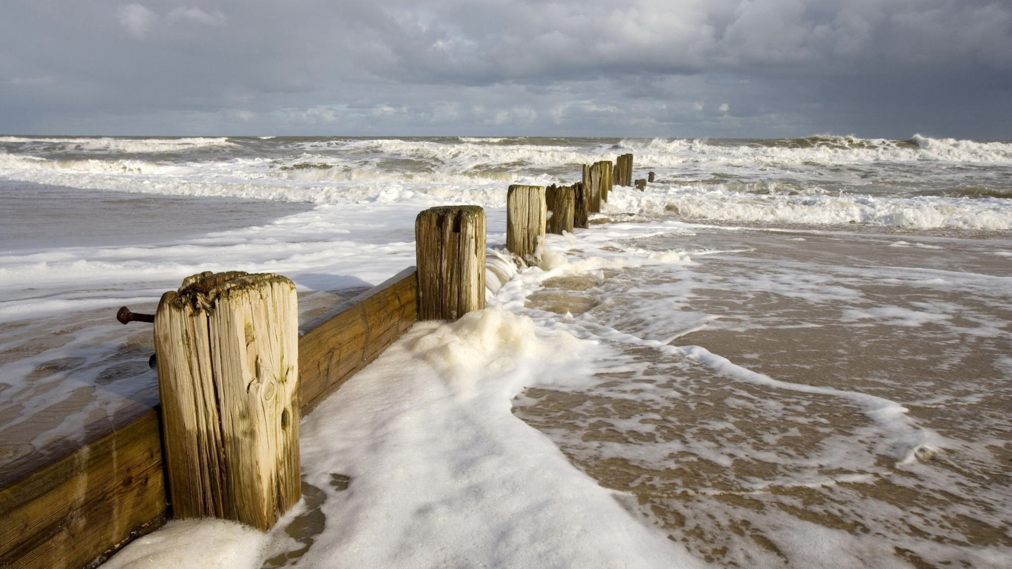 3840x2160 Preview wallpaper sea, storm, waves, dirty water, stakes, coast, foam