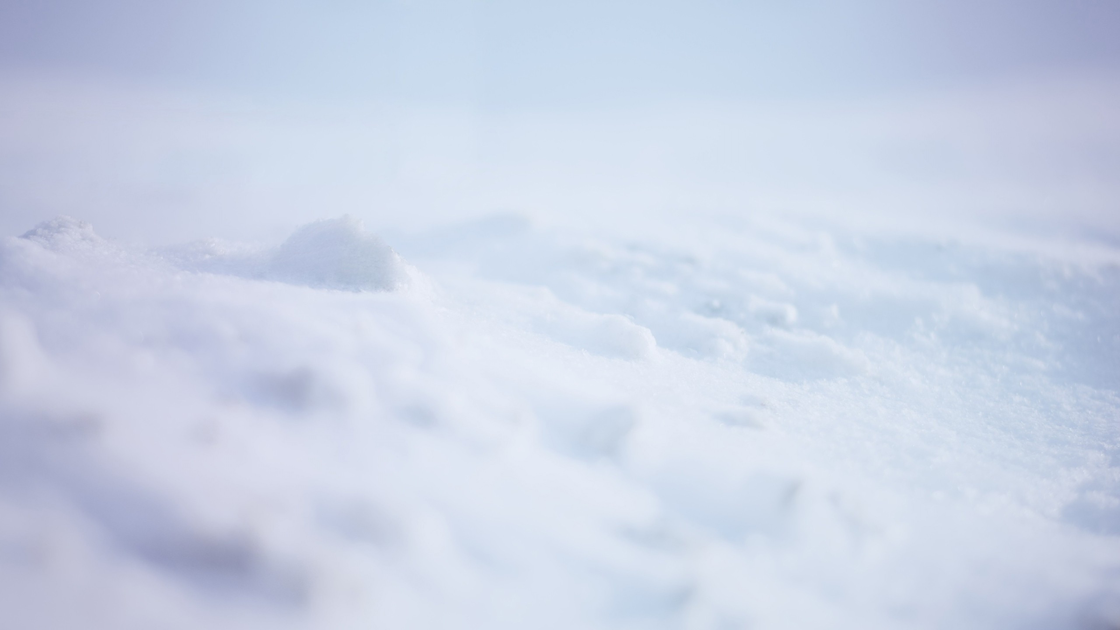 3840x2160  Wallpaper snow, white, background, surface
